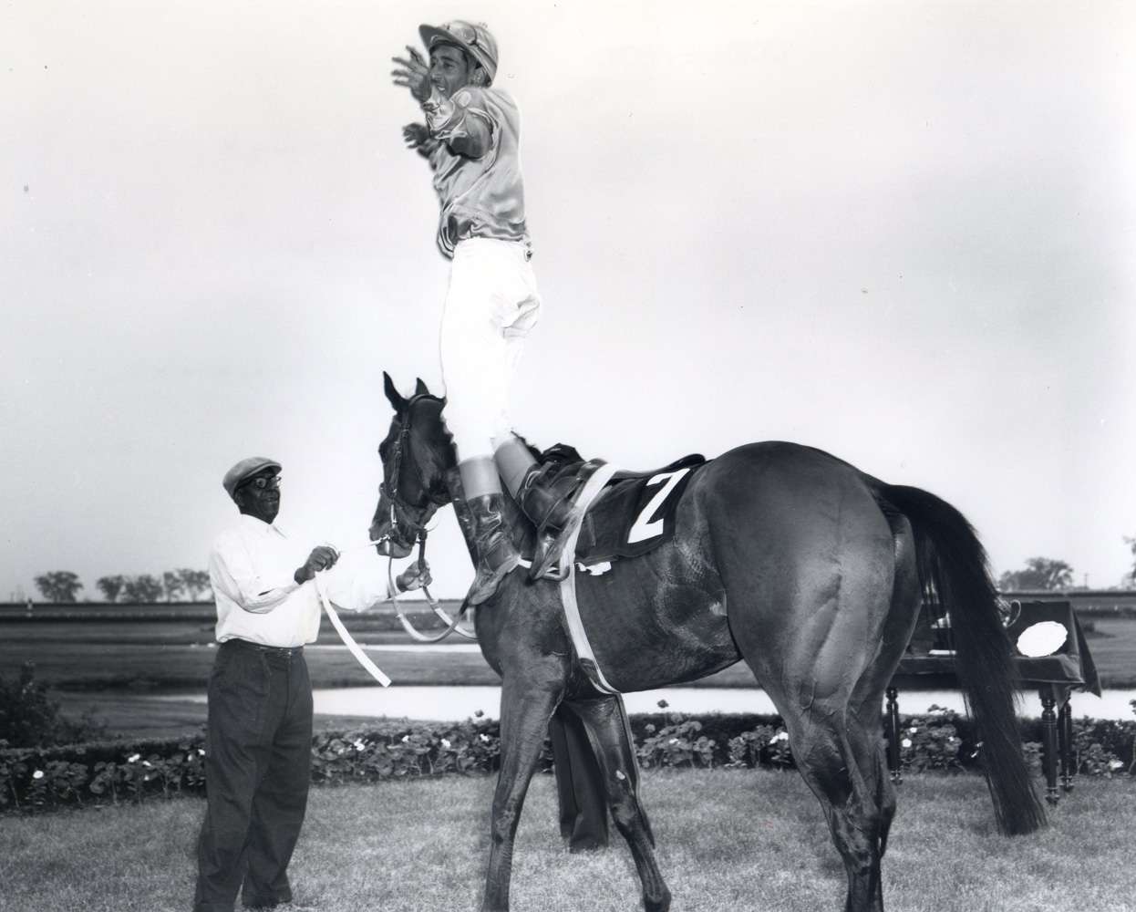 Avelino Gomez jumping off Victoria Park after winning the 1960 Queen's Plate at Woodbine (Michael Burns/Museum Collection)