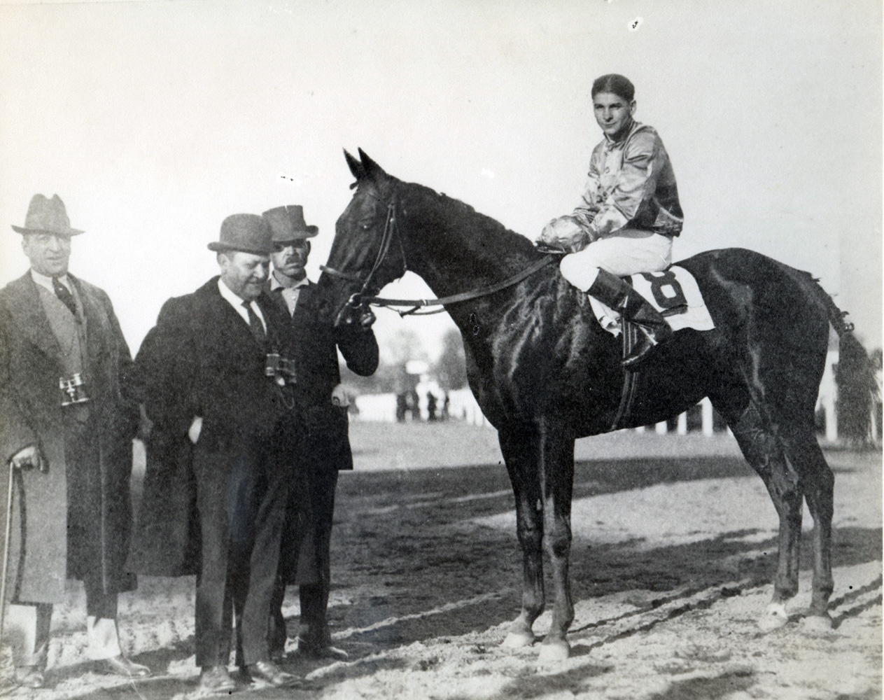 Albert Johnson and Morvich in the winner's circle for the 1921 Pimlico Futurity (Museum Collection)