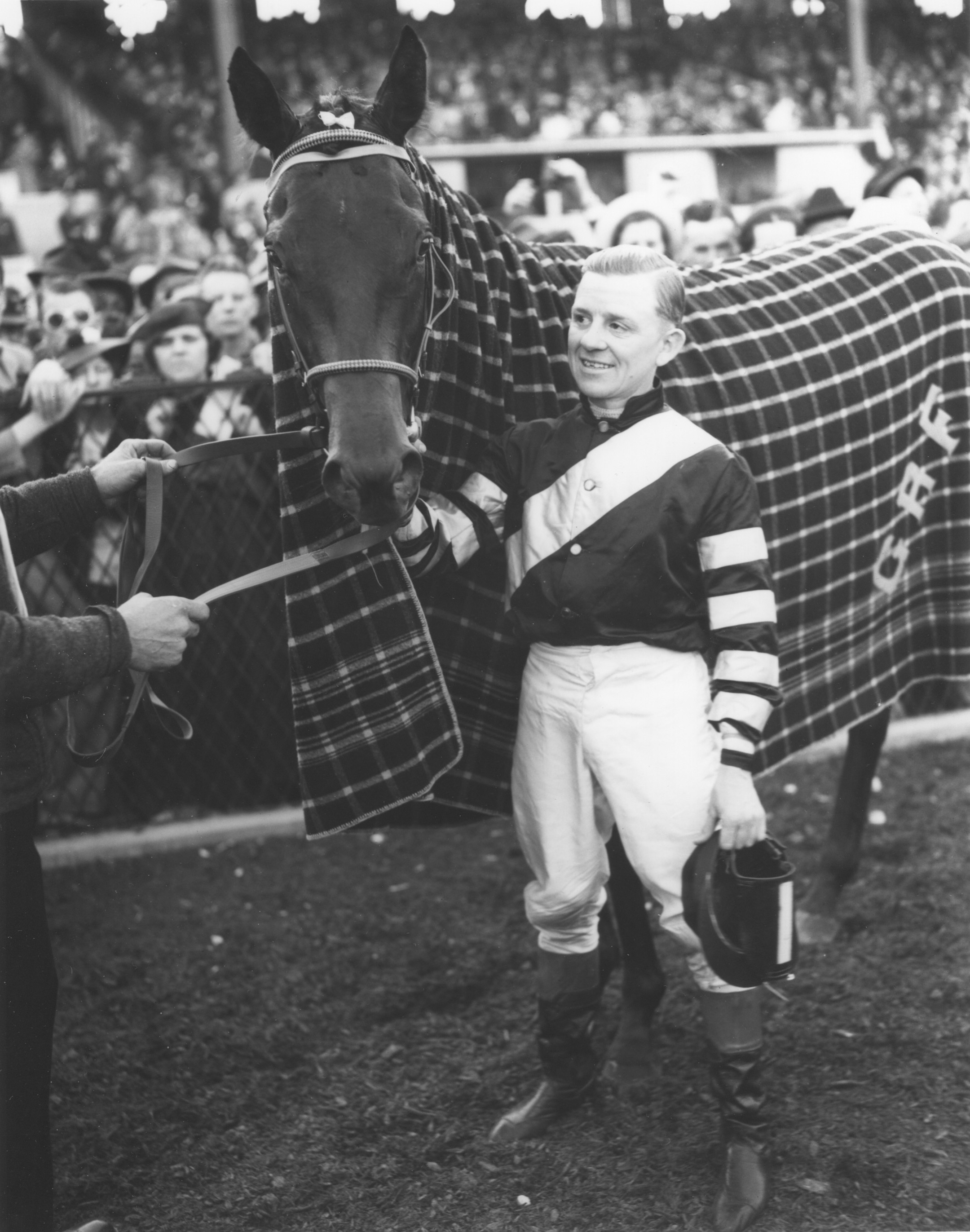 Charles Kurtsinger with War Admiral after winning the 1937 Preakness Stakes at Pimlico (Keeneland Library Morgan Collection/Museum Collection)