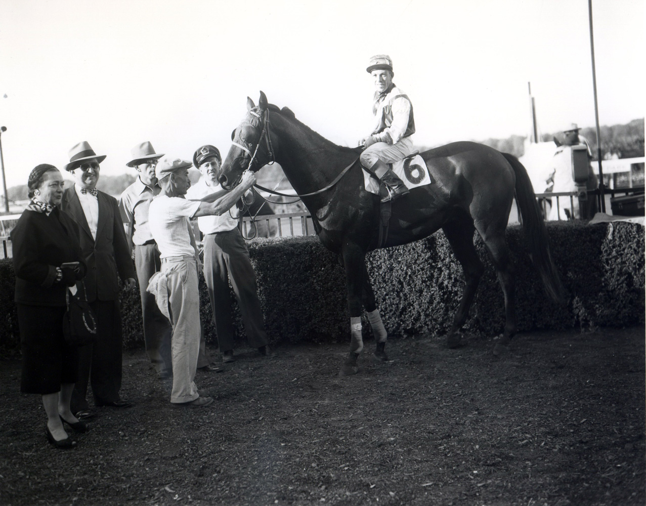 Conn McCreary and Platan in the winner's circle with trainer Harry Trotsek after winning the 1953 Lawrence Realization at Belmont Park (Keeneland Library Morgan Collection/Museum Collection)