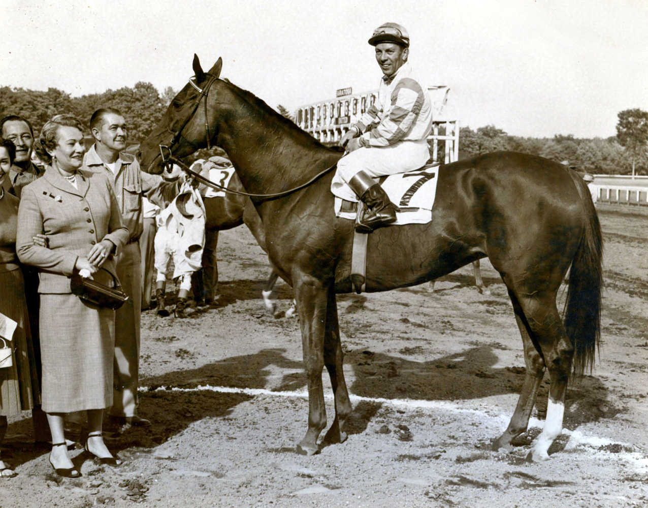 Conn McCreary and Lavender Hill in the winner's circle after winning the 1954 Diana Handicap at Saratoga (Museum Collection)