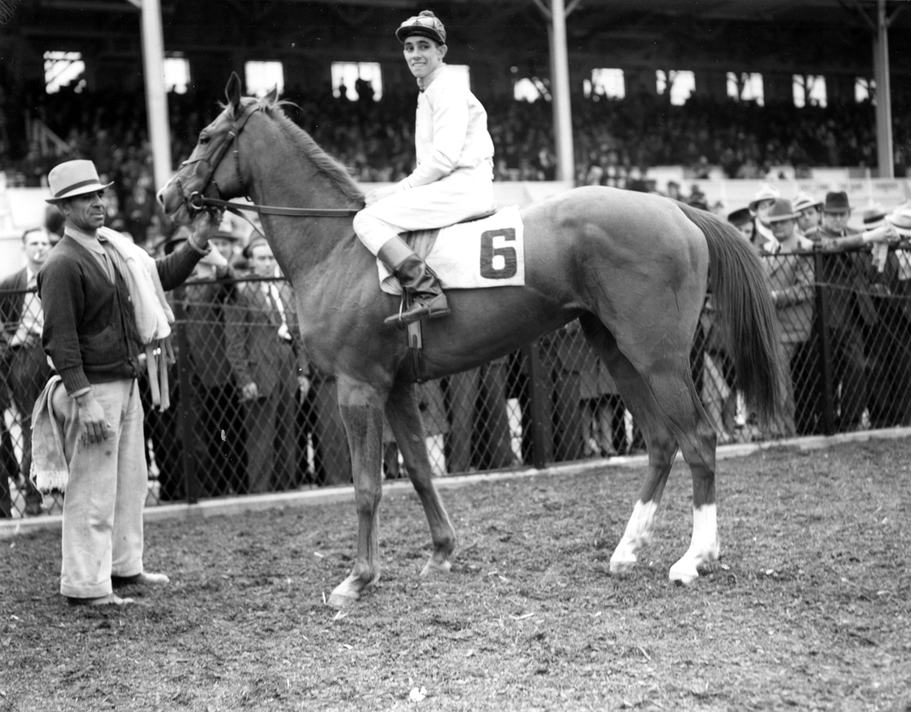 Ralph Neves and an unidentified horse in the winner's circle at Pimlico, April 1940 (Keeneland Library Morgan Collection/Museum Collection)