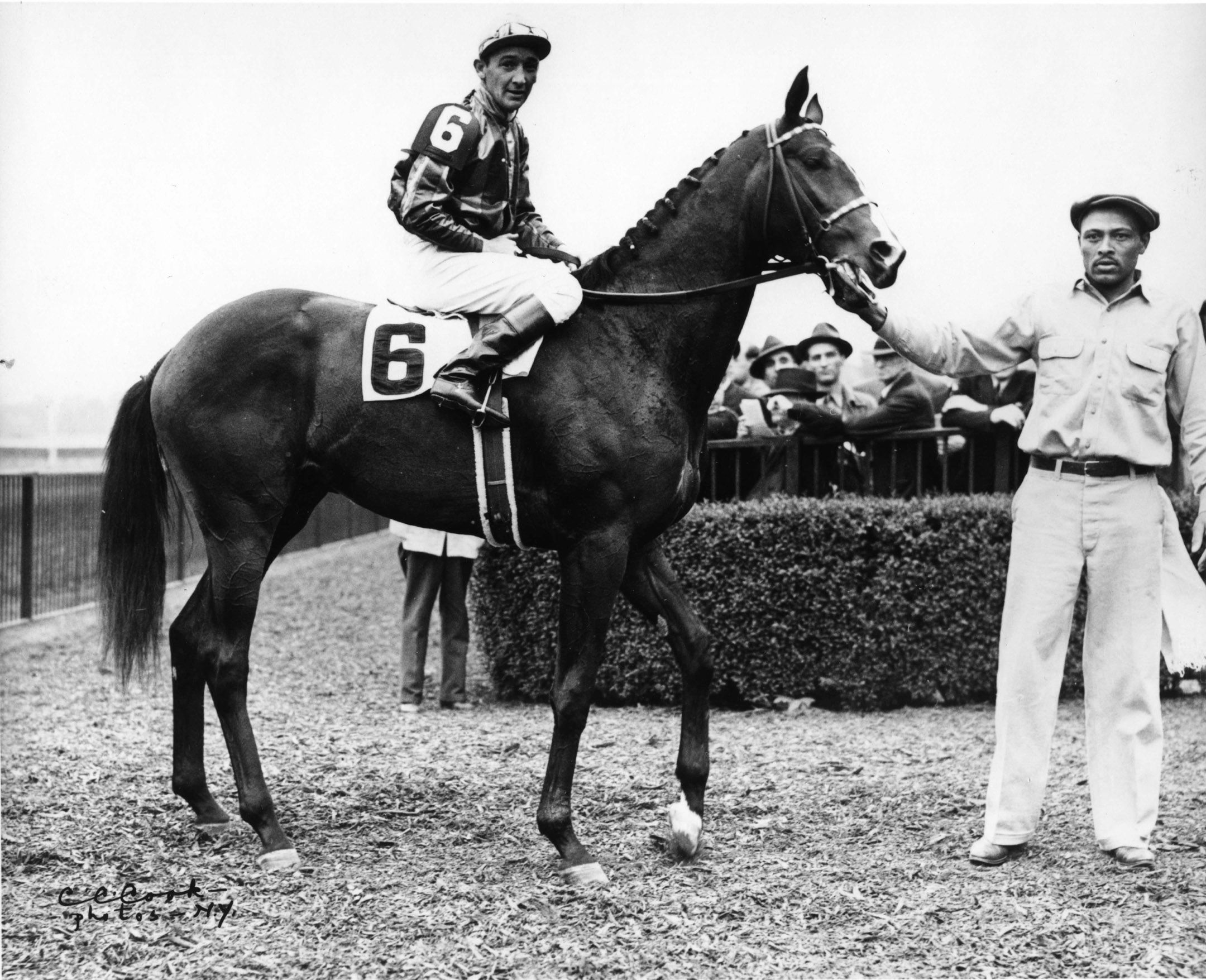 Alfred Roberston and Amphitheatre in the winner's circle at Belmont Park, May 1941 (Keeneland Library Cook Collection/Museum Collection)