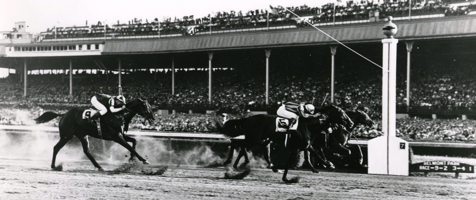 Alfred Robertson and Amphitheatre winning the 1941 Futurity Trial at Belmont (Keeneland Library Cook Collection/Museum Collection)