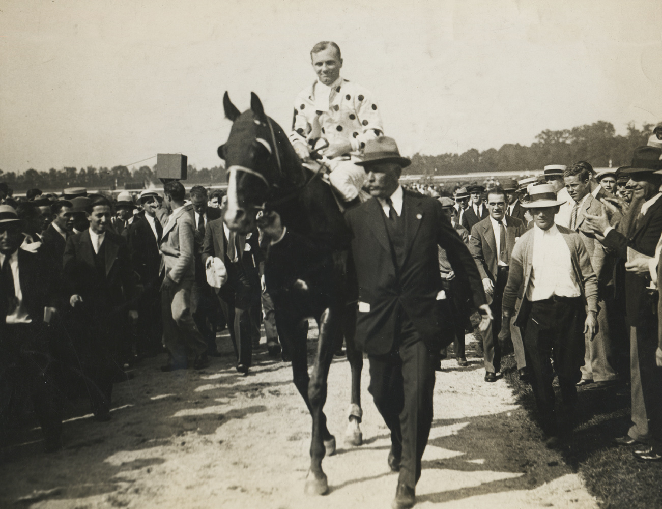 Owner William Woodward, Jr. leading in Gallant Fox and Earl Sande after winning the 1930 Lawrence Realization at Belmont Park (Pictorial Press Photos/Museum Collection)