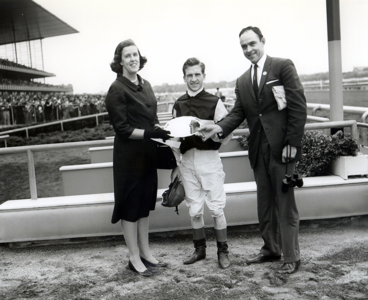 Trophy presentation for the 1961 Juvenile Stakes at Aqueduct, won by Bobby Ussery and Sunrise County (Keeneland Library Morgan Collection/Museum Collection)