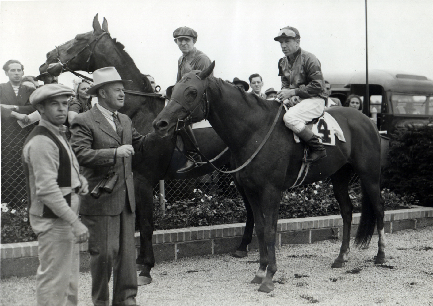 George Woolf and Whirlaway in the winner's circle in 1942 (Museum Collection)