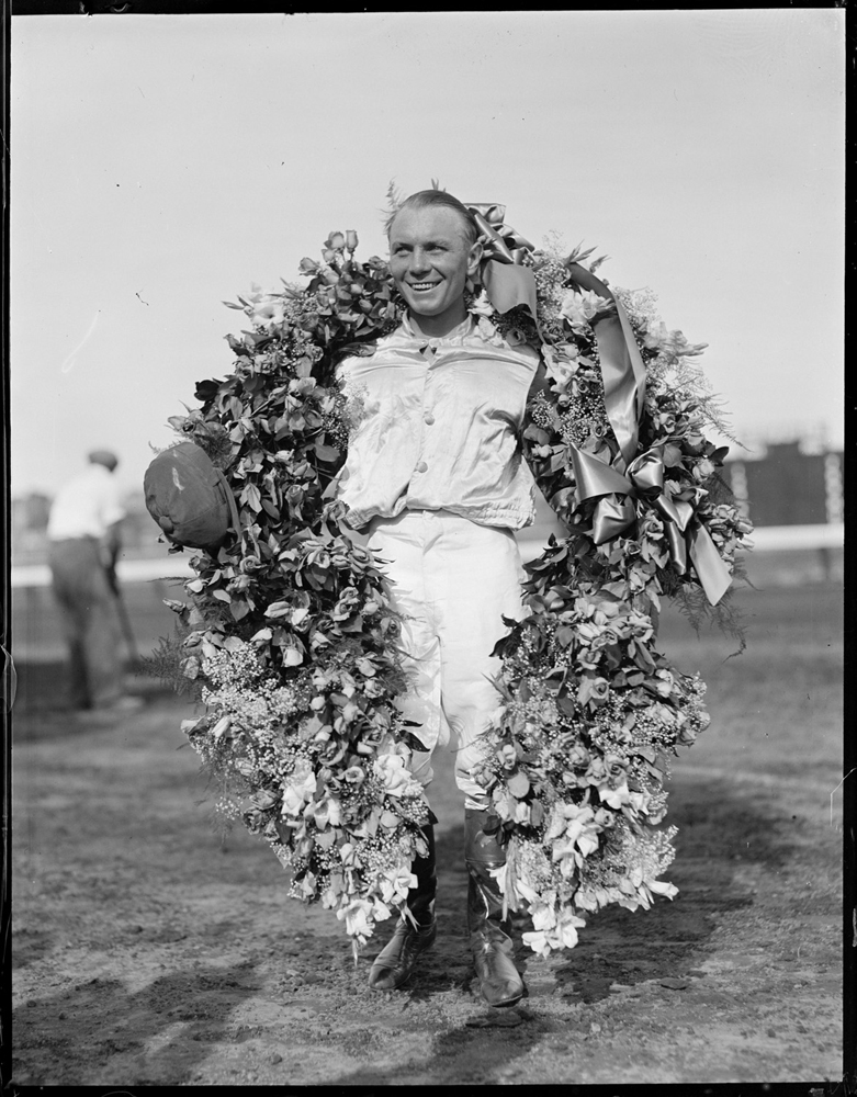 Raymond Workman with Time Supply's wreath after winning the 1936 Massachusetts Handicap at Suffolk Downs (Courtesy of the Boston Public Library, Leslie Jones Collection)