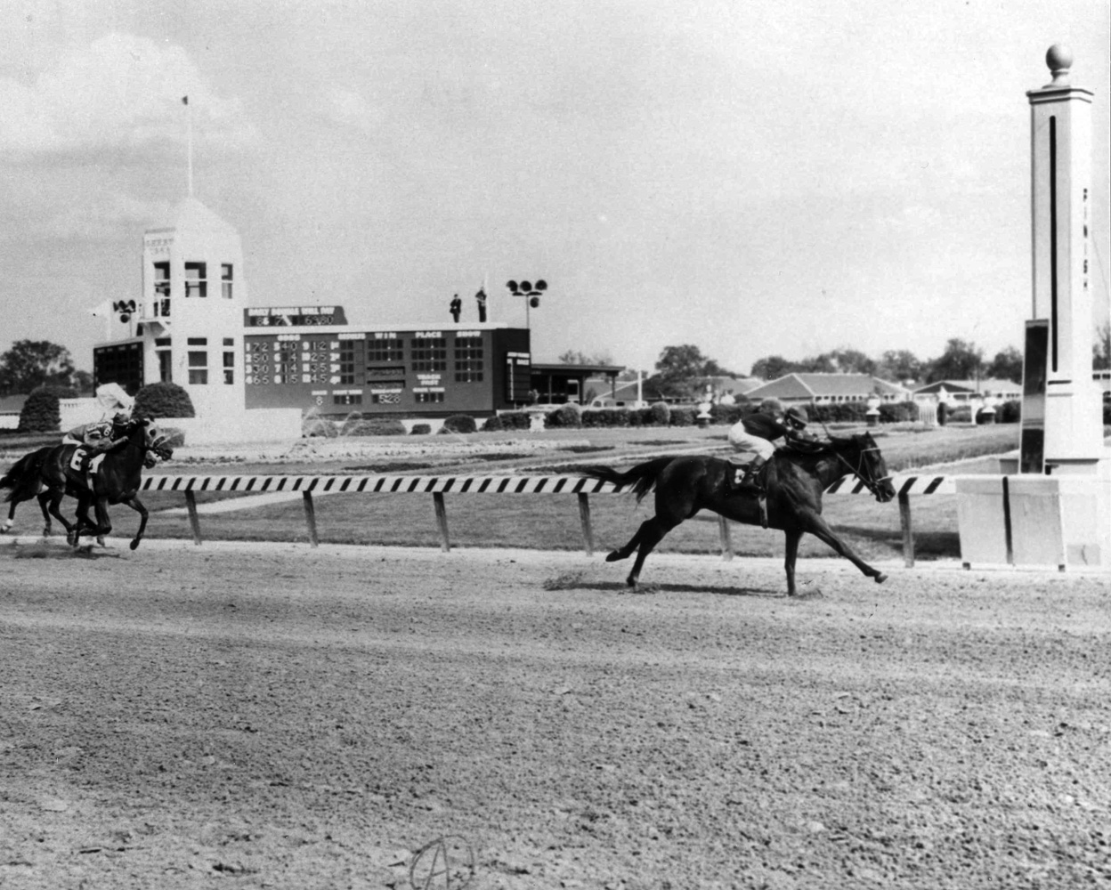 Manny Ycaza and Dark Mirage win the 1968 Kentucky Oaks at Churchill Downs (Bob Coglianese/Museum Collection)