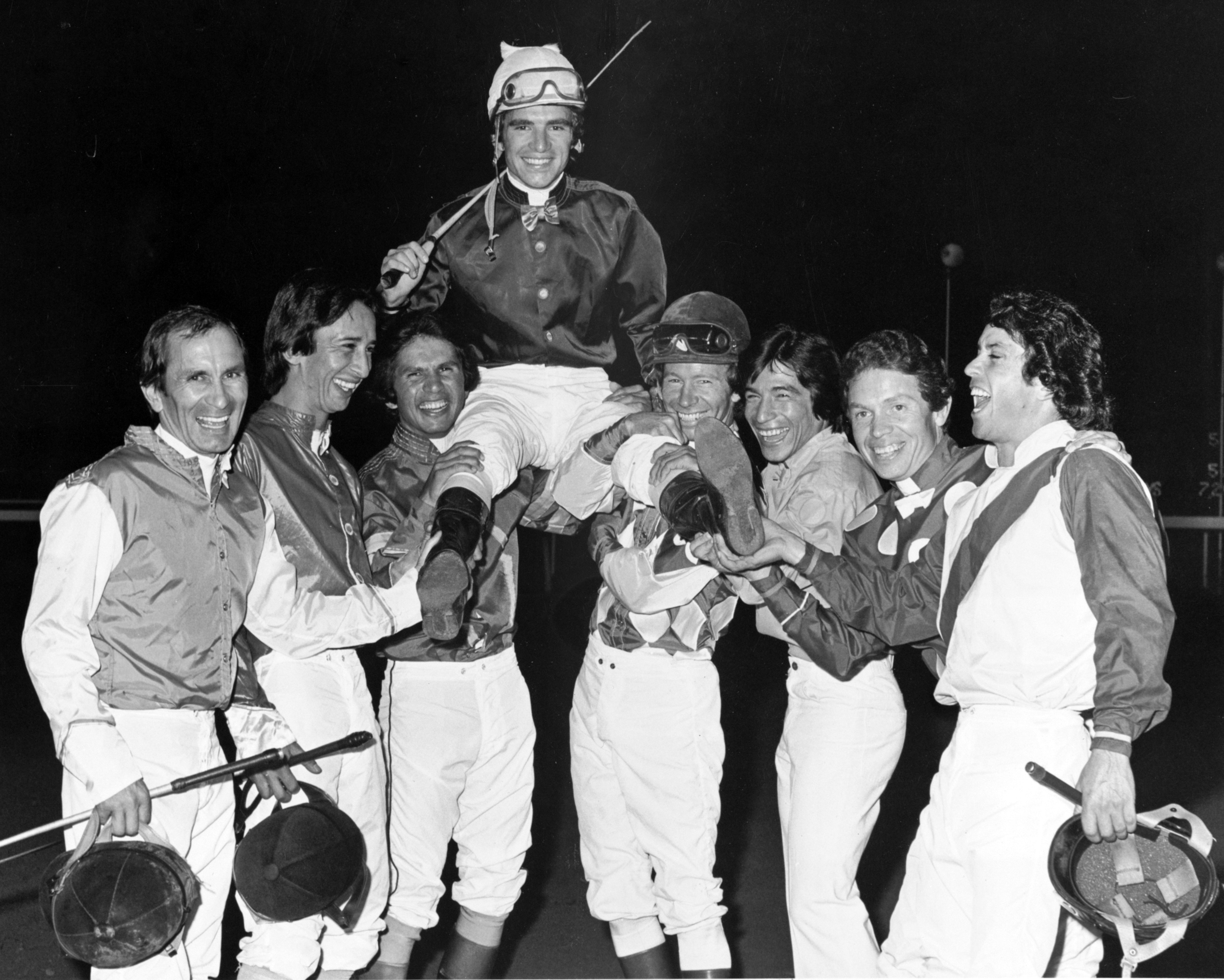 Darrel McHargue being lifted up in celebration by the Hollywood Park jockey colony after his second consecutive Moonlight Derby win (Keeneland Library Thoroughbred Times Collection)