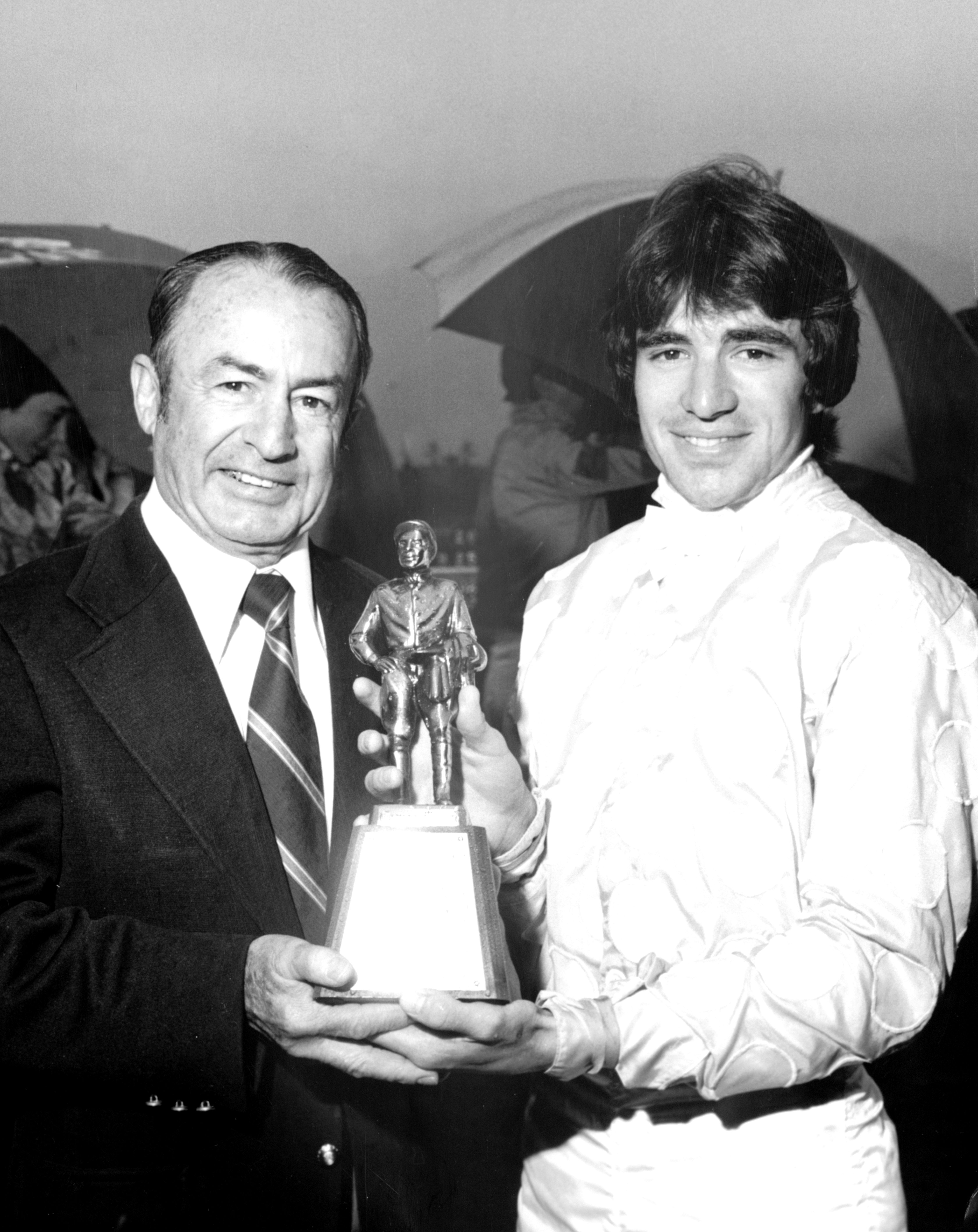 Darrel McHargue is presented the 1978 George Woolf Memorial Jockey Award by Ted Atkinson (Keeneland Library Thoroughbred Times Collection)