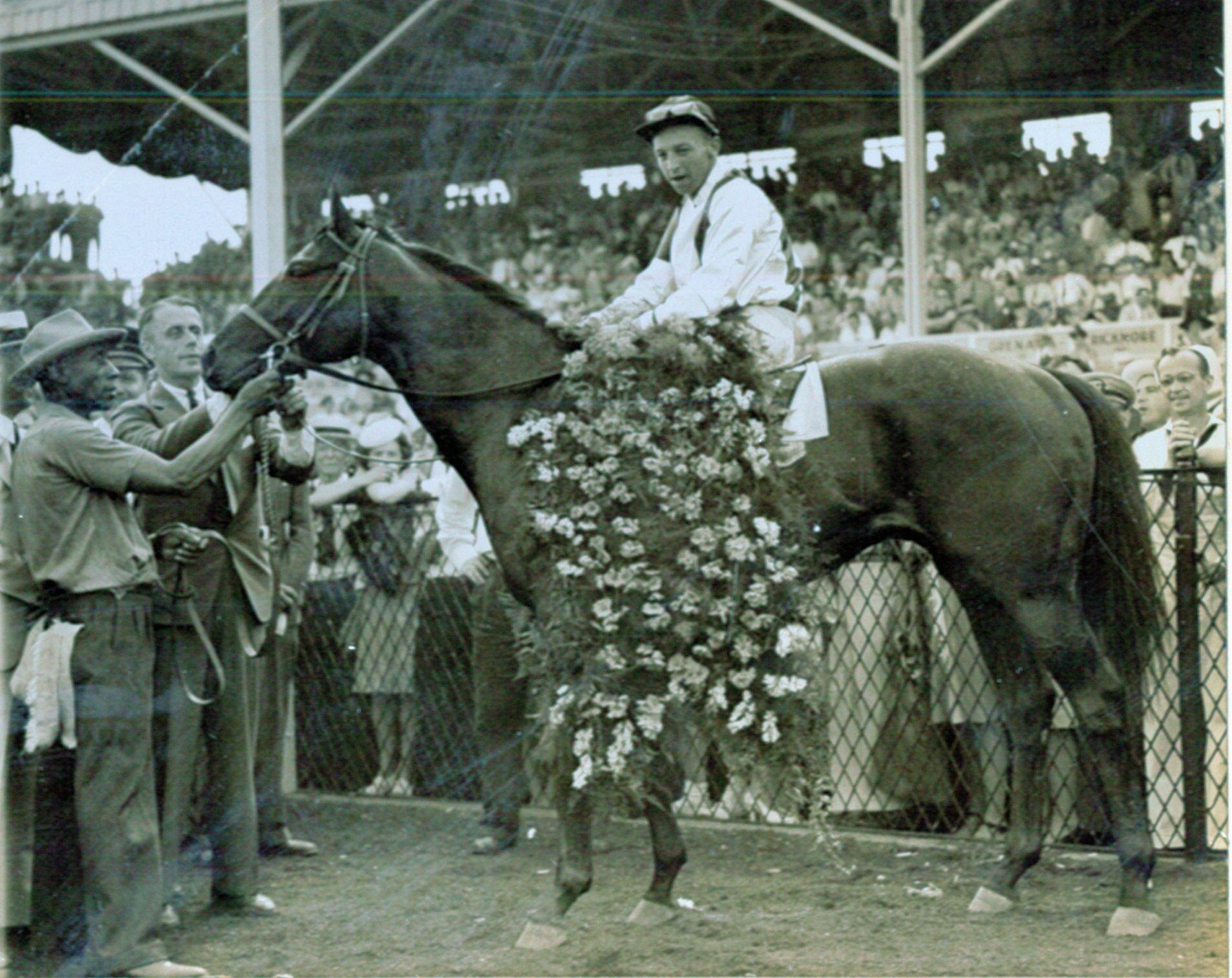 Wayne Wright aboard Polynesian after winning the 1945 Preakness at Pimlico (Bert Morgan/Museum Collection)
