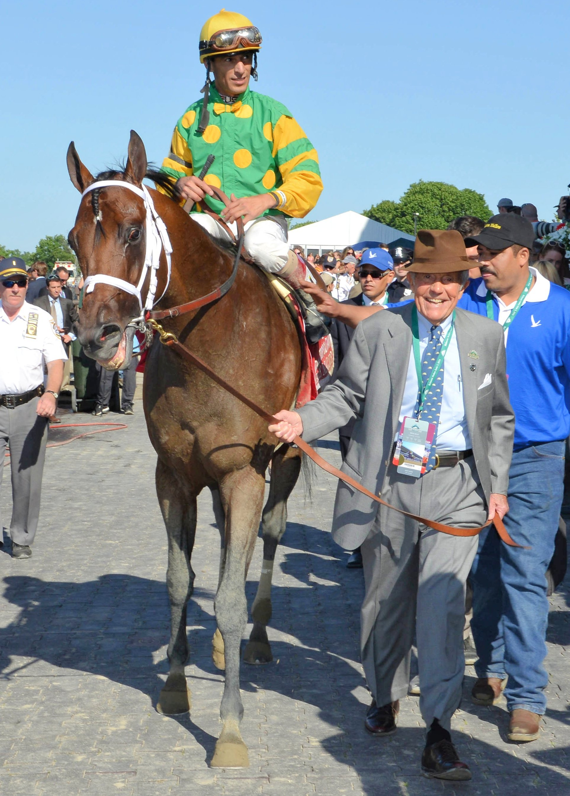 Cot Campbell leading in Palace Malice (John Velazquez up) after winning a race (NYRA)