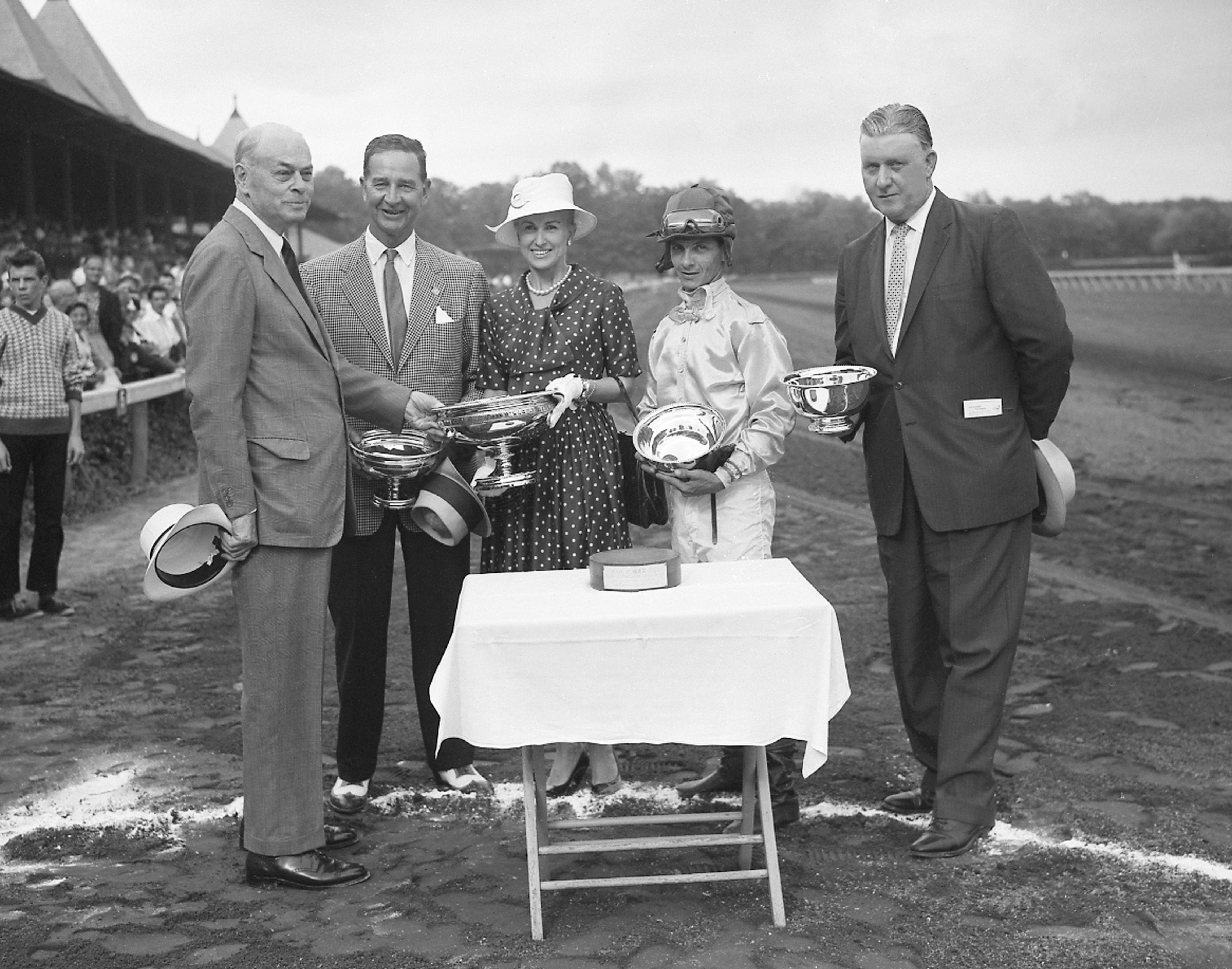 Walter M. Jeffords, Sr. presents the winning connections of Tompion - owners Mr. and Mrs. C. V. Whitney, jockey Bill Hartack, and trainer JJ Greely -  with the 1960 Travers Stakes trophy at Saratoga (Keeneland Library Morgan Collection)