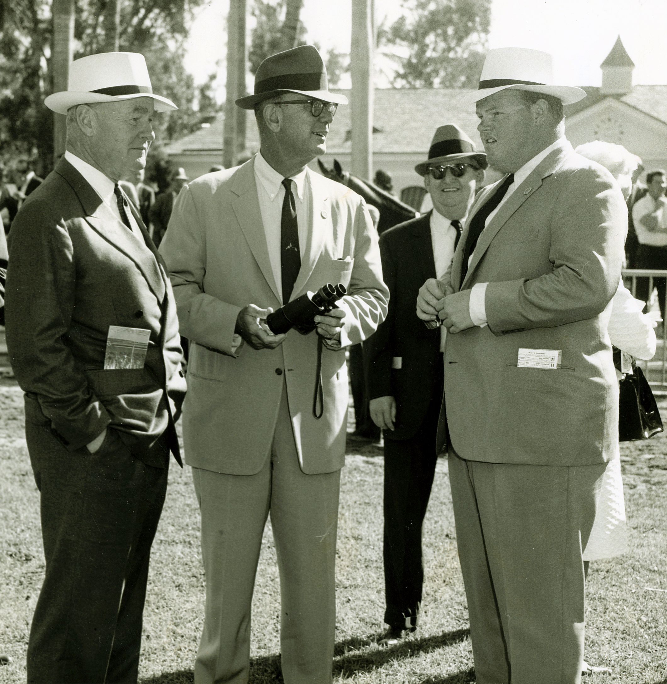 Ogden Phipps, Bull Hancock, and Dinny Phipps in the paddock in 1966 (Keeneland Library Thoroughbred Times Collection)