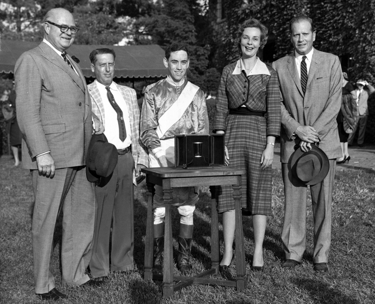 E. P. Taylor presents a trophy to Reynolds and Alice Headley Bell at Keeneland (Keeneland Library Thoroughbred Times Collection)