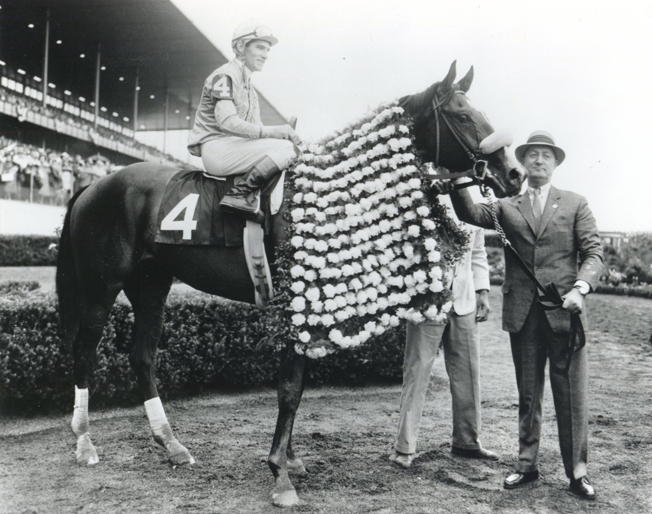 Paul Mellon and Quadrange, Manuel Ycaza up, in the winner's circle for the 1964 Belmont Stakes at Aqueduct (Museum Collection)