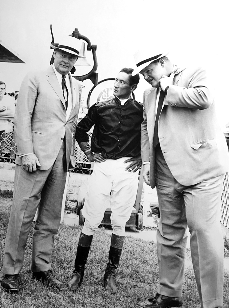 """Ogden Phipps (left) with his son Ogden Mills """"Dinny"""" Phipps and jockey Braulio Baeza in 1960 (Keeneland Library Thoroughbred Times Collection)"""