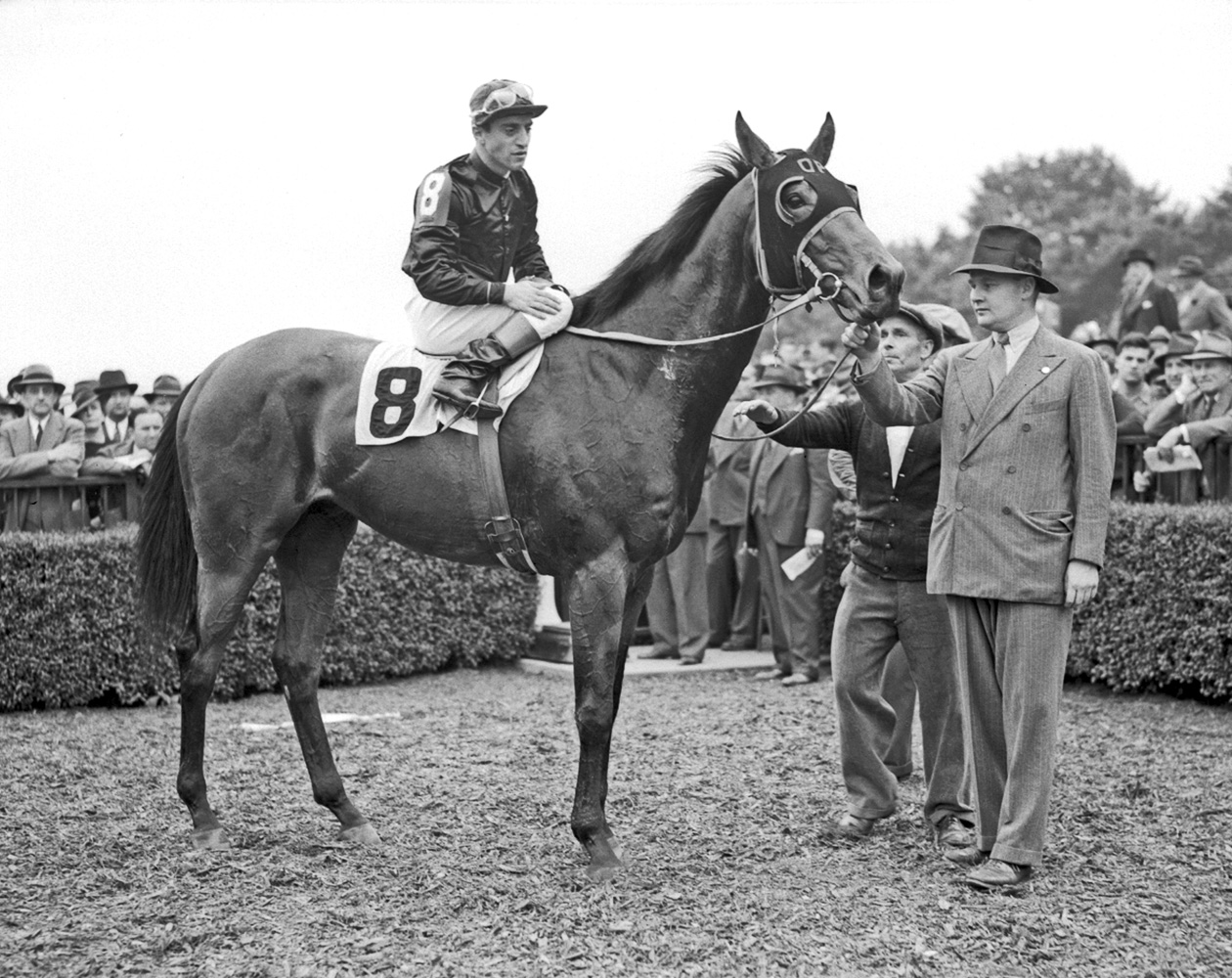 Ogden Phipps holding King Cole in the winner's circle (Keeneland Library Cook Collection)