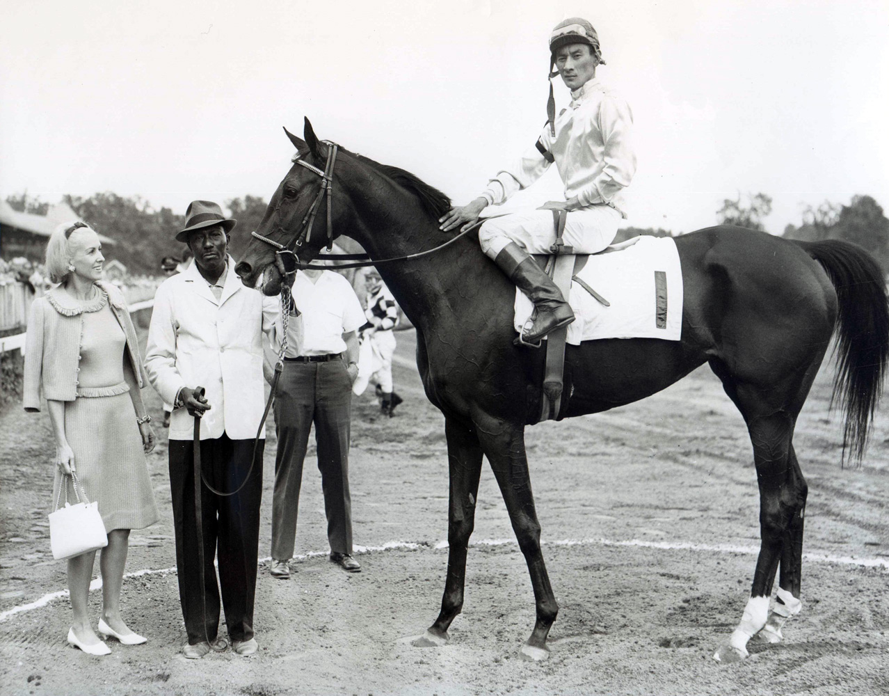 Marylou Whitney in the winner's circle at Saratoga with an unidentified horse (Braulio Baeza up) (NYRA/Museum Collection)