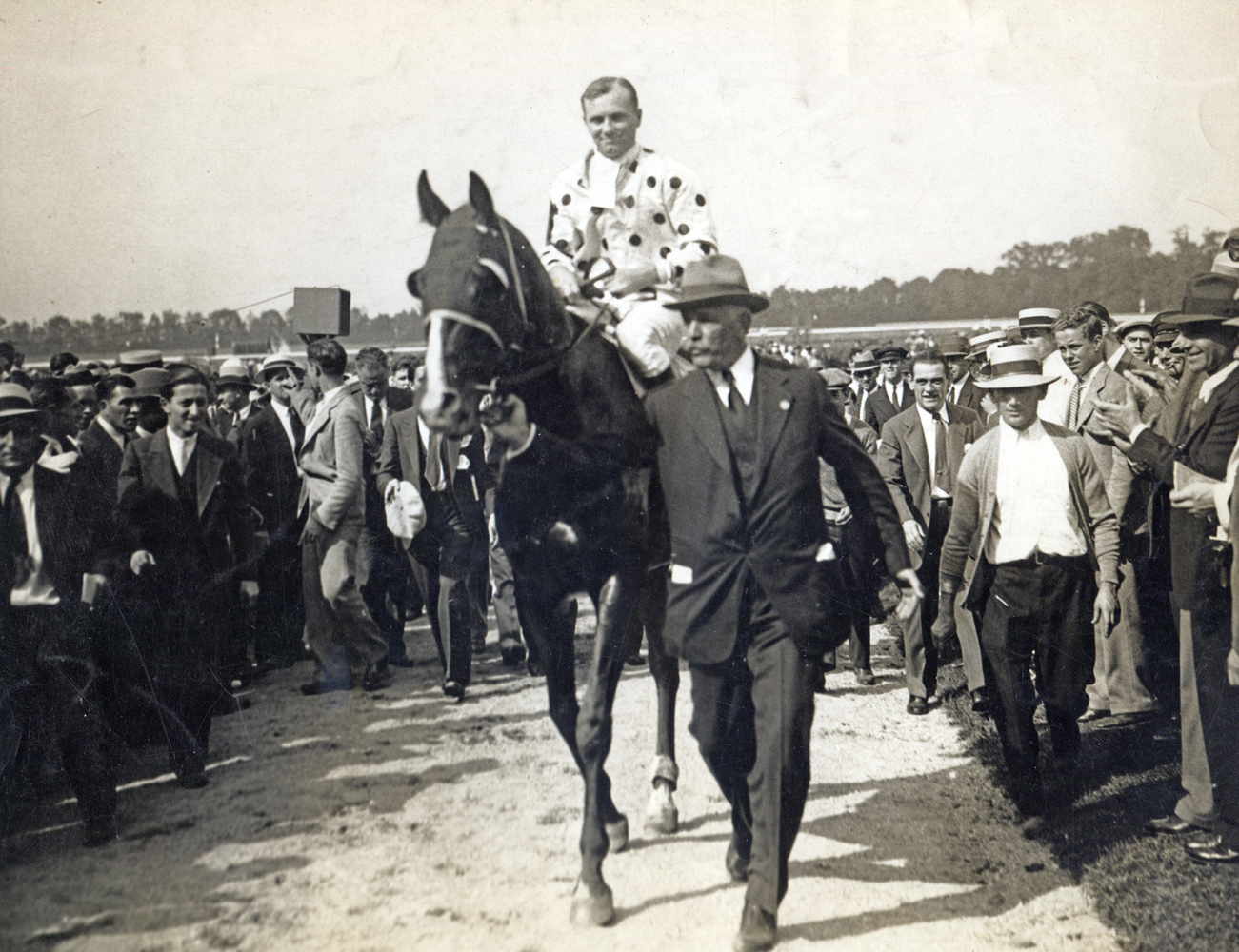 William Woodward, Sr. leads in Gallant Fox (Earl Sande up) after winning the 1930 Lawrence Realization at Belmont Park (Pictorial Press Photos/Museum Collection)