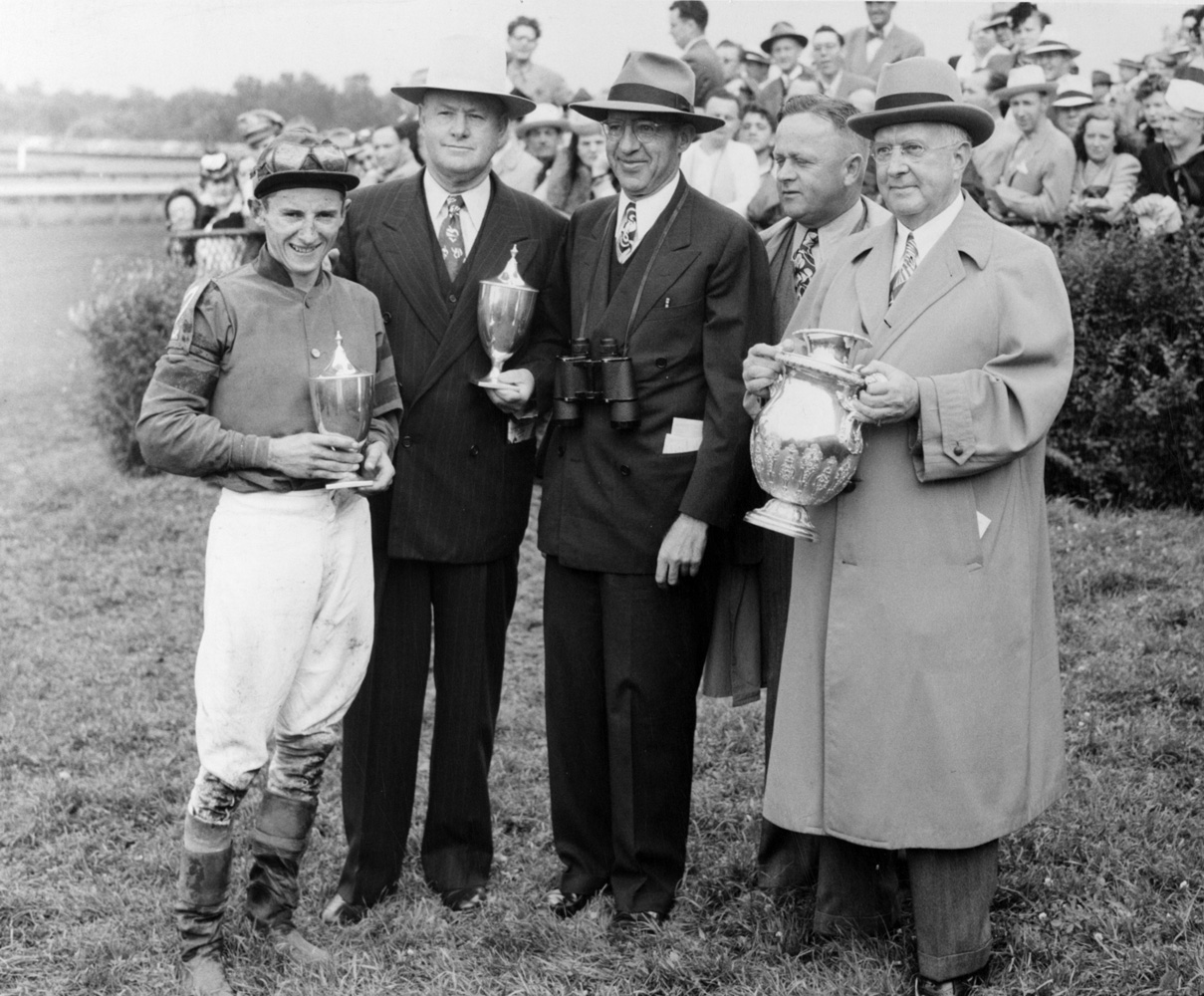 Jockey Doug Dodson, Ben Jones, B.F. Lindheimer, Jimmy Jones and Warren Wright accept the trophies for the 1945 Arlington Classic, won by Pot O'Luck (Keeneland Library Thoroughbred Times Collection)