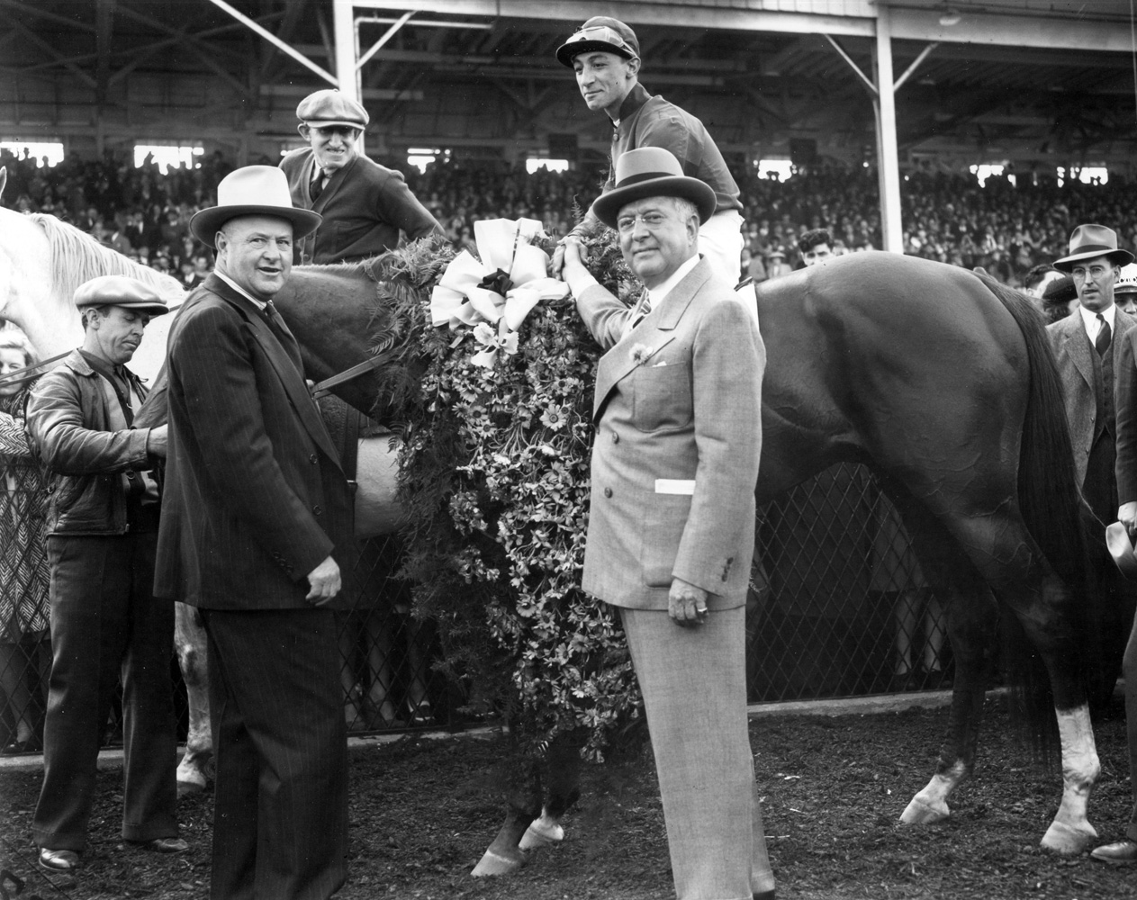 Trainer Ben Jones with Whirlaway (Eddie Arcaro up) and owner Warren Wright in the winner's circle for the 1941 Preakness Stakes at Pimlico (Keeneland Library Morgan Collection/Museum Collection)