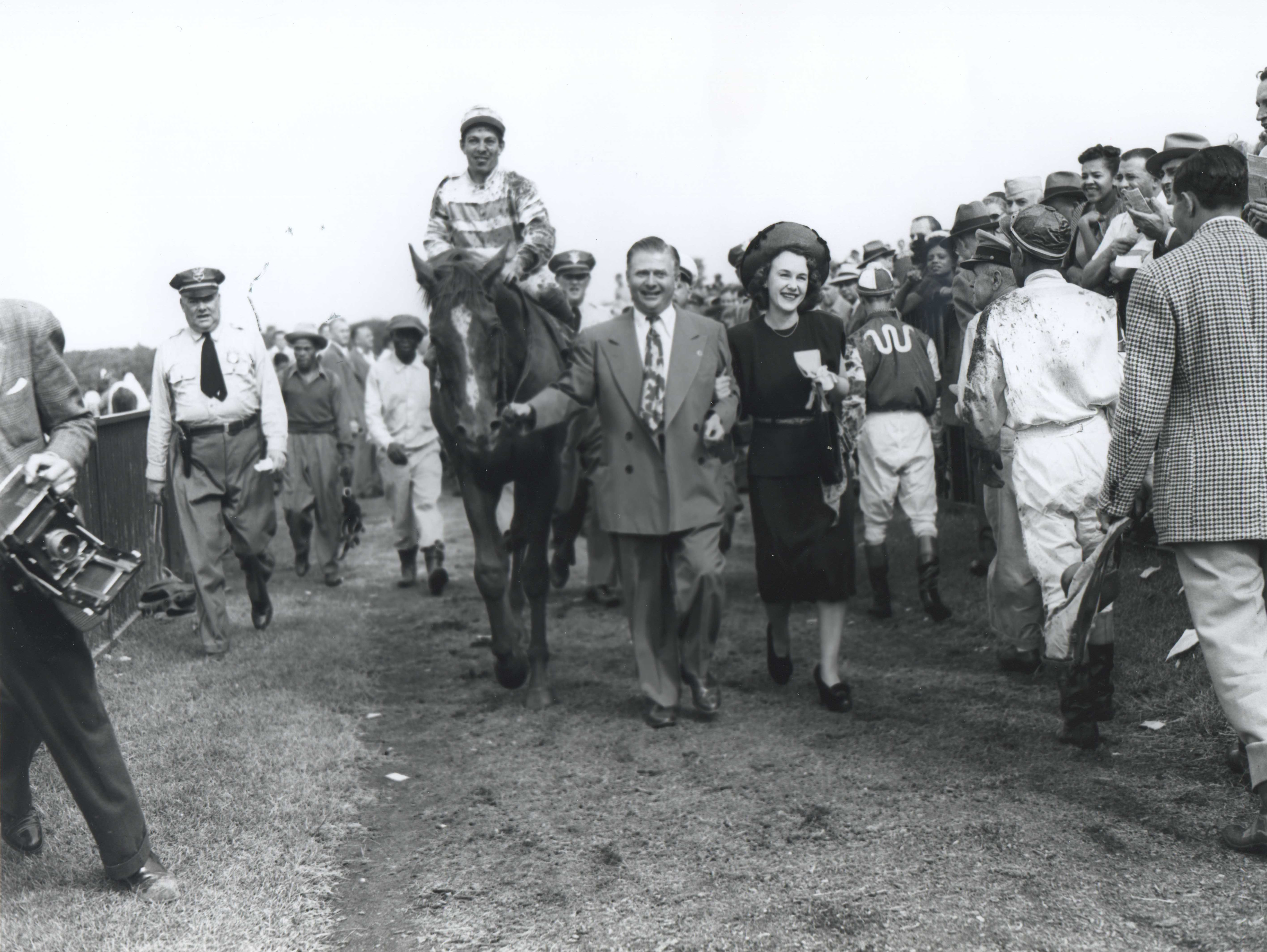 Hirsch and Ethel Jacobs lead in Stymie (Conn McCreary up) after winning the 1947 International Gold Cup at Empire City (Keeneland Library Morgan Collection/Museum Collection)