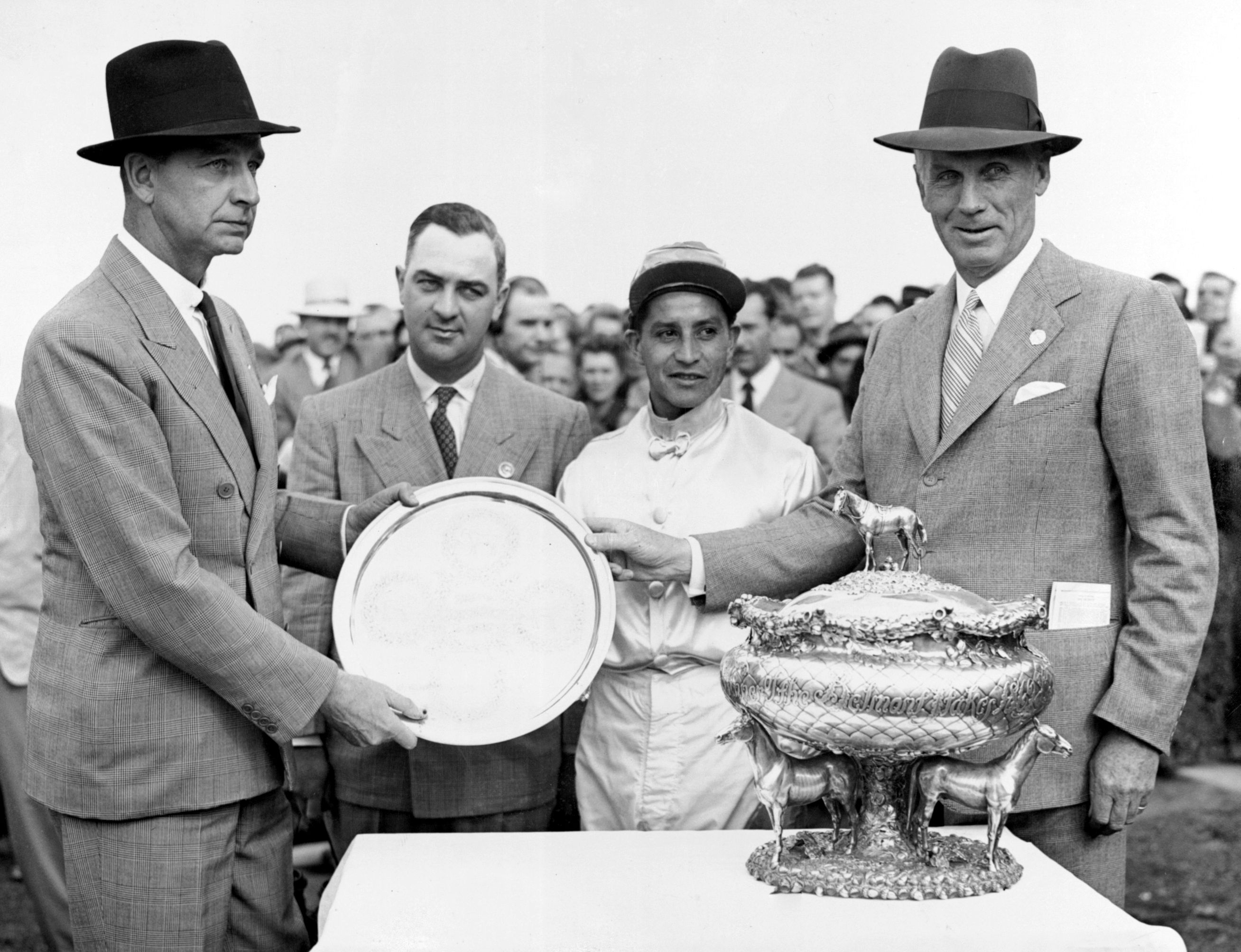 From left, C. V. Whitney, Syl Veitch, Ruperto Donoso, and George D. Widener, 1947 Belmont Stakes presentation (Keeneland Library Morgan Collection)