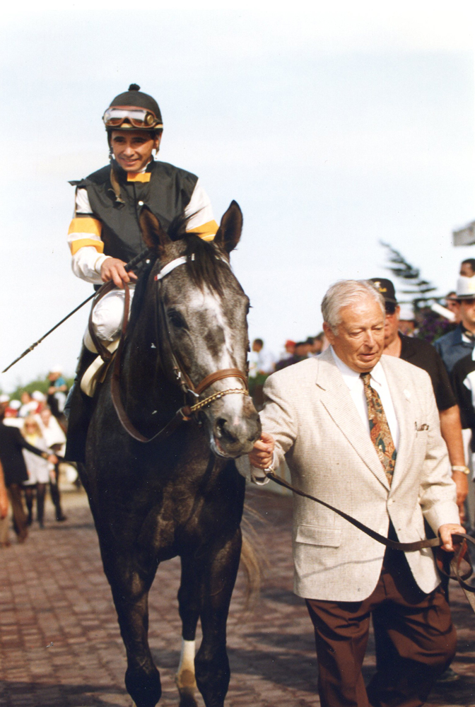 Holy Bull (Mike Smith up) being led in by trainer Jimmy Croll after winning the 1994 Metropolitan at Belmont Park (Barbara Ann Giove Coletta/Museum Collection)