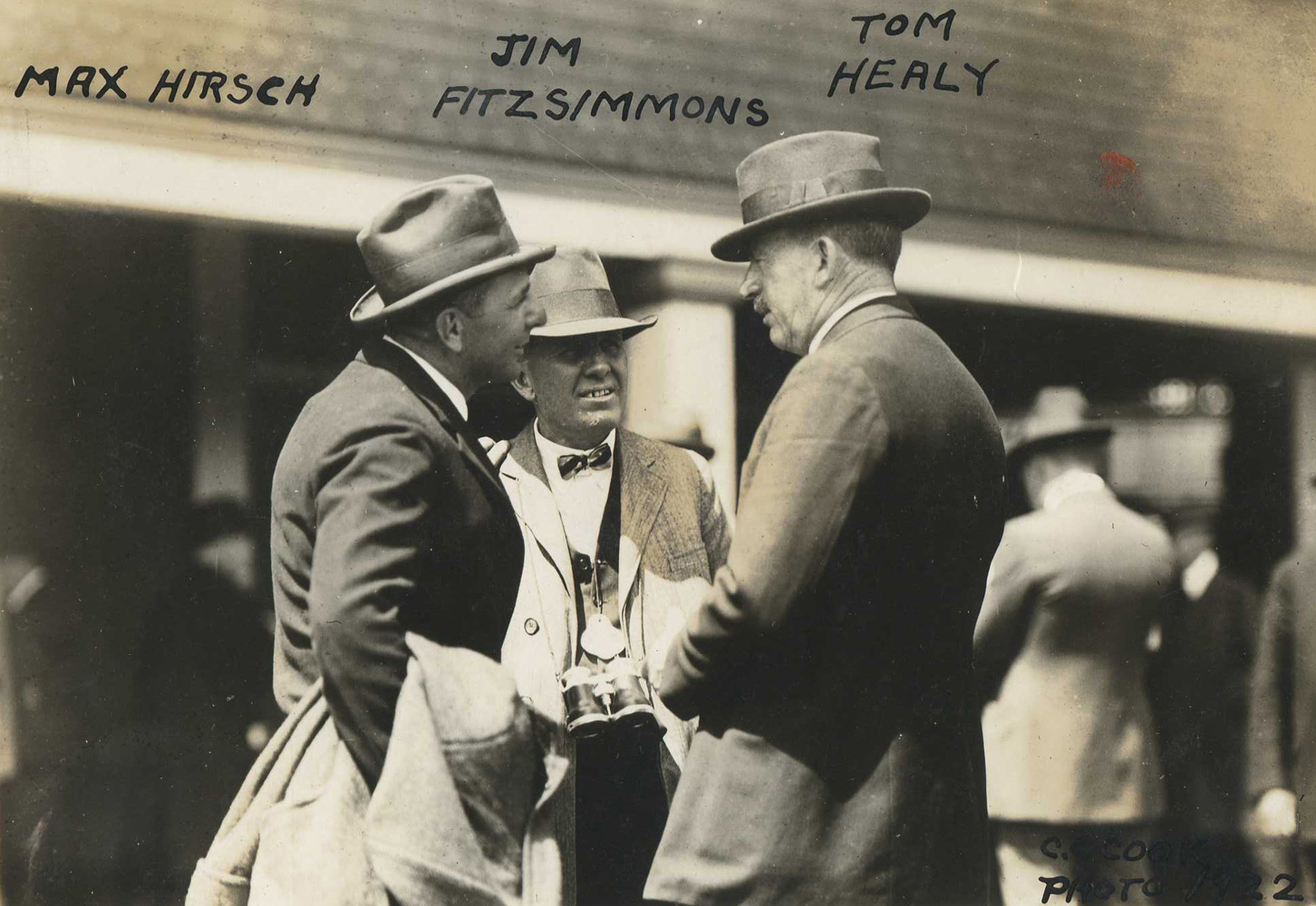 """A young James """"Sunny Jim"""" Fiitzsimmons (center) with fellow future Hall of Fame trainers Max Hirsch and T. J. Healey in 1922 (C. C. Cook/Museum Collection)"""