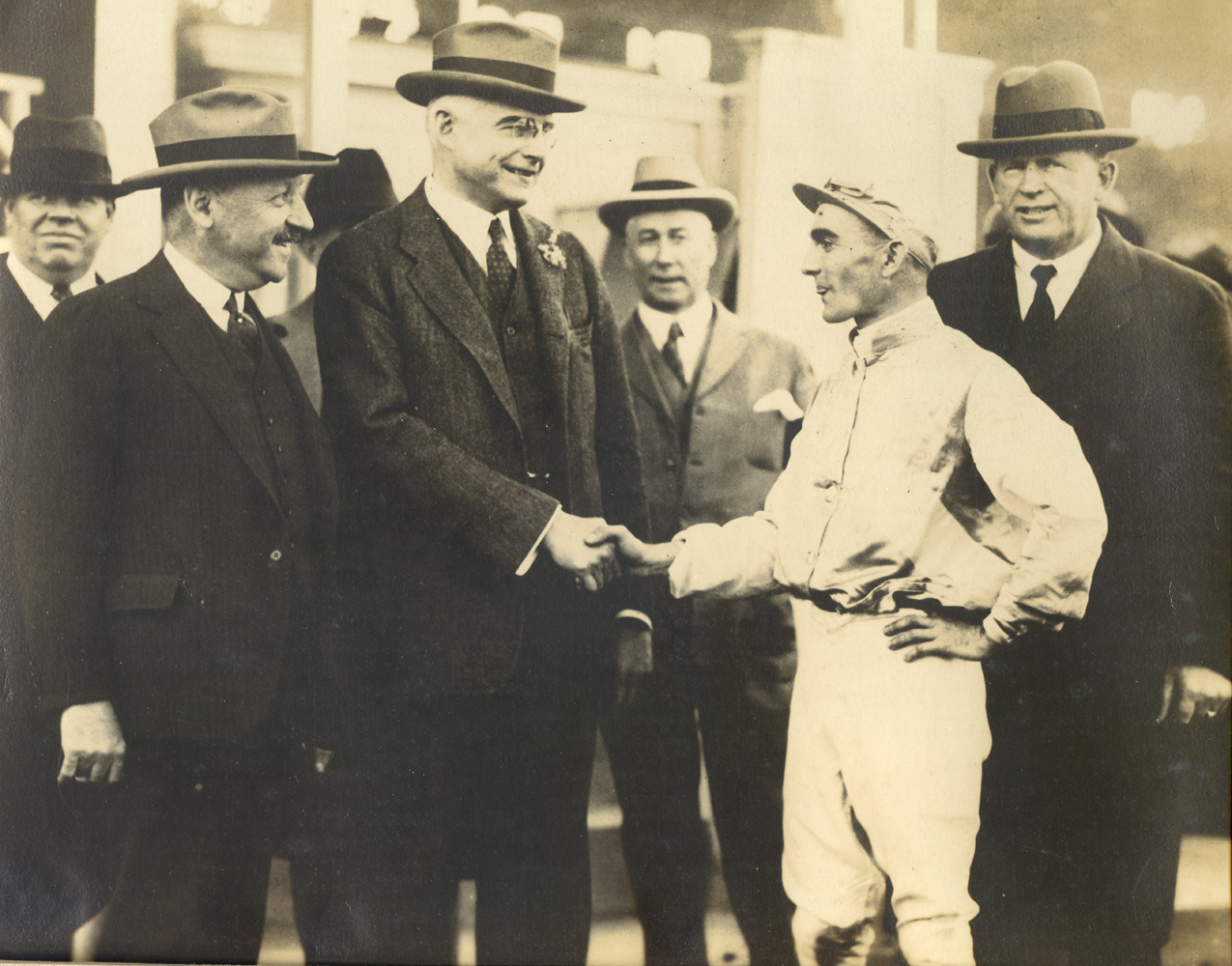 Owner Walter J. Salmon, Maryland Governor Albert Ritchie, jockey John Maiben, and trainer T. J. Healey celebrating their 1926 Preakness victory with Display (Drucker and Company/Museum Collection)