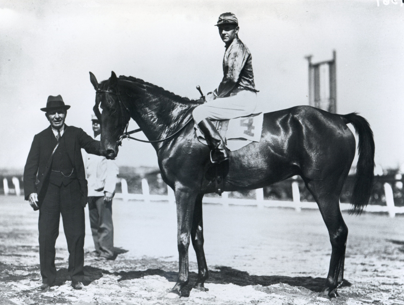 Trainer Thomas Hitchcock holding Actor (George Bostwick up) in the winner's circle for the 1930 Bushwick Steeplechase at Aqueduct (Keeneland Library Cook Collection/Museum Collection)