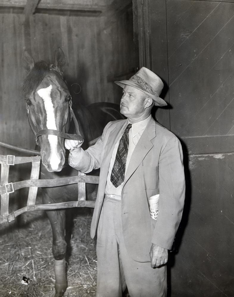 Ben Jones with Calumet Farm's Sun Again in the barn (Museum Collection)