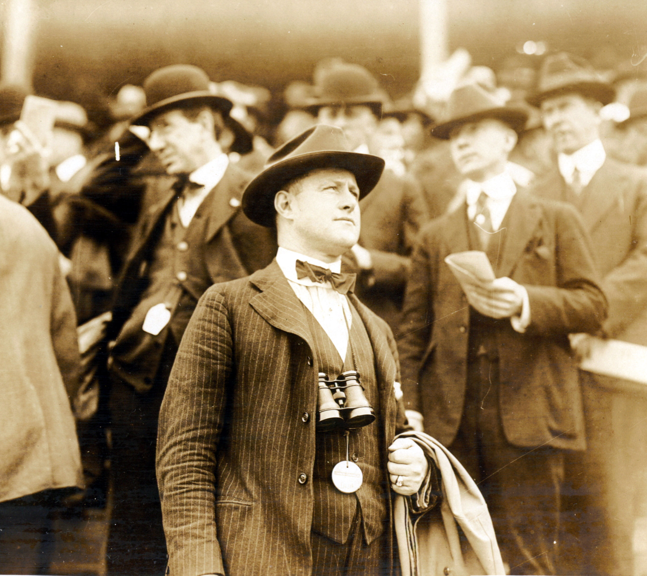 Ben Jones watching a race from the grandstand area of an unidentified track (Museum Collection)