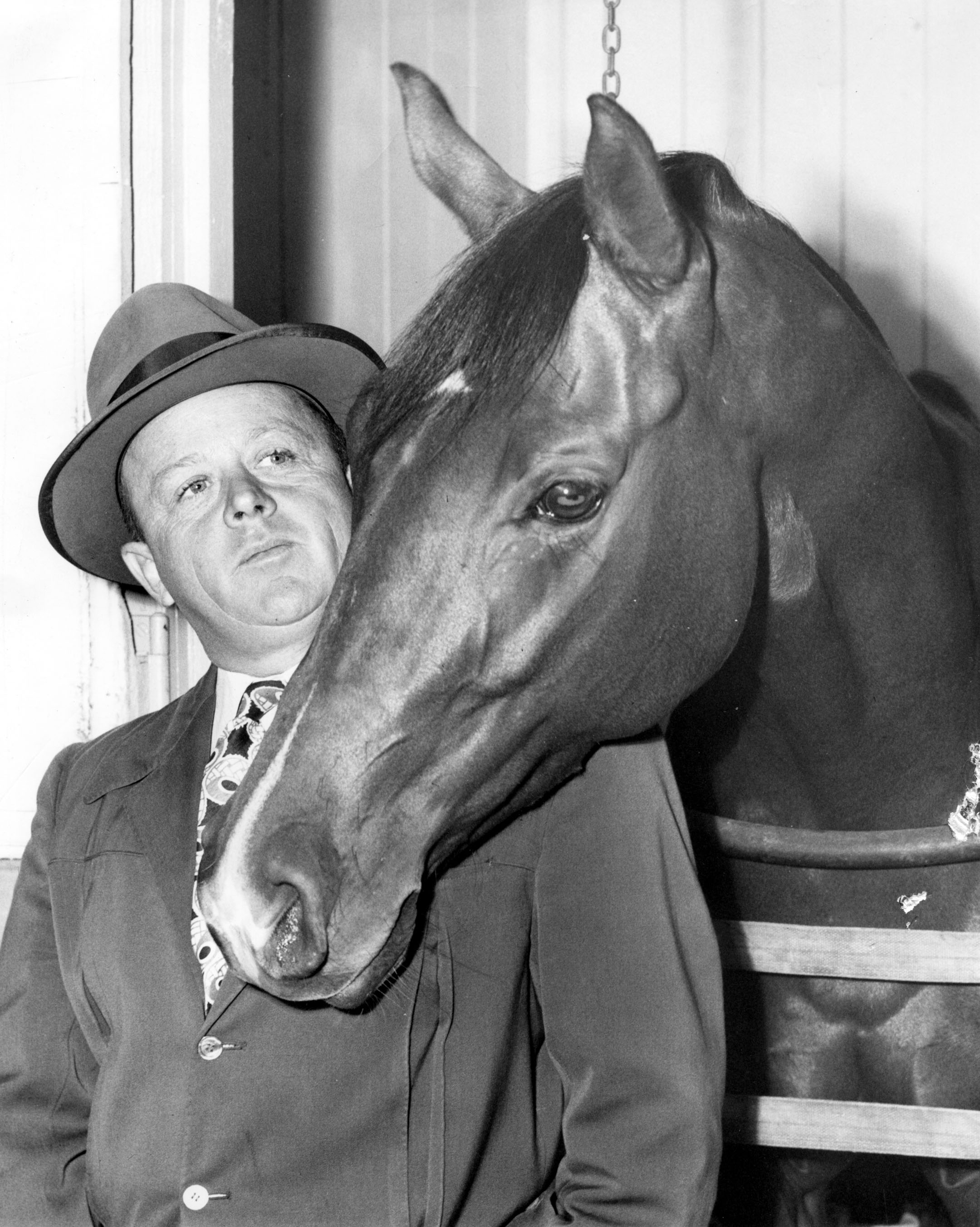 Jimmy Jones with Two Lea, one of the Hall of Fame horses he conditioned for Calumet Farm (Museum Collection)