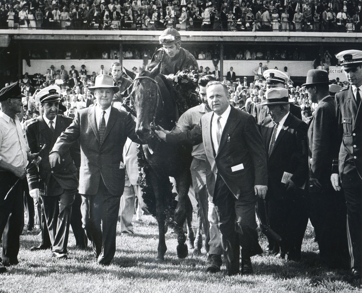 """Father-son training duo, Ben and H. A. """"Jimmy"""" Jones lead in Tim Tam (Ismael Valenzuela up) after winning the 1958 Kentucky Derby (Museum Collection)"""