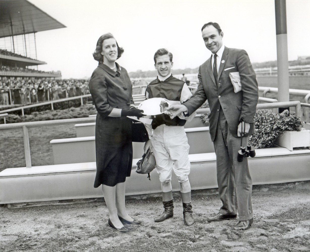 Jockey Bobby Ussery and trainer T. J. Kelly at the trophy presentation for the 1961 Juvenile at Aqueduct, won by Sunrise County (Keeneland Library Morgan Collection/Museum Collection)