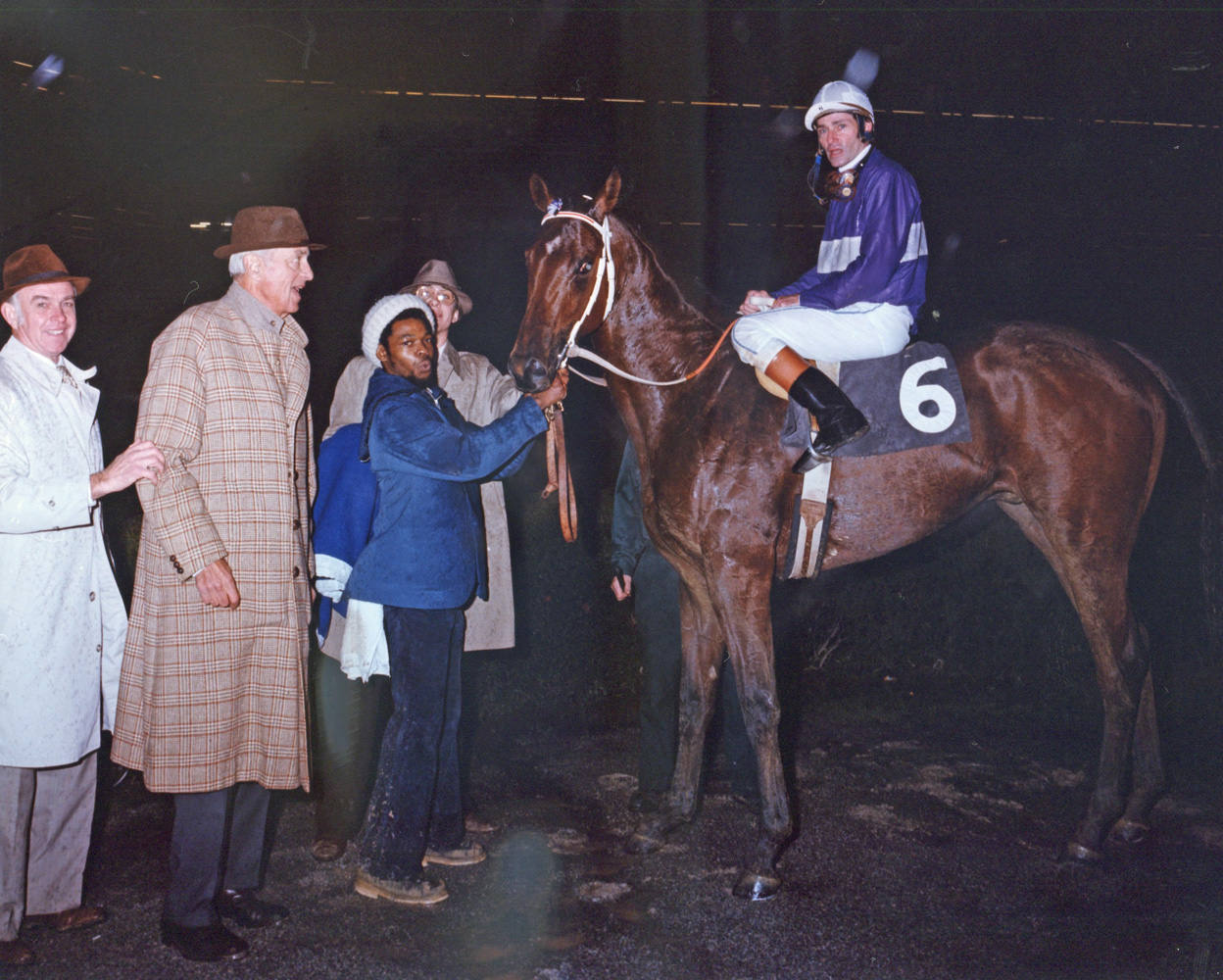 Trainer T. J. Kelly in the winner's circle with Plugged Nickle.
