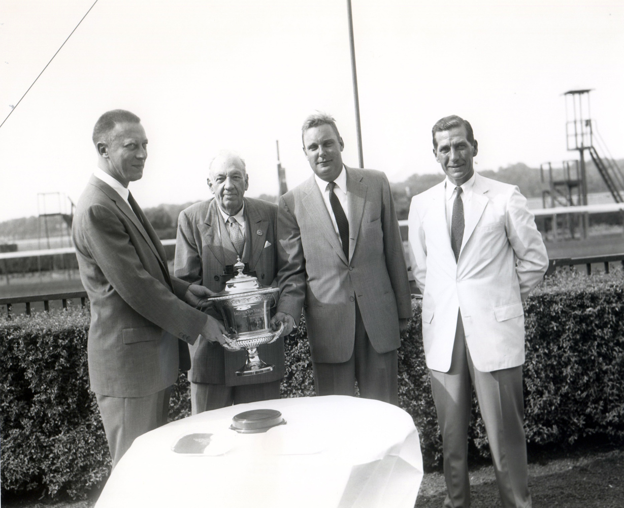 Trophy presentation for the winning connections of the 1957 Suburban Handicap at Belmont Park, won by Traffic Judge and trained by James Maloney (Keeneland Library Morgan Collection/Museum Collection)
