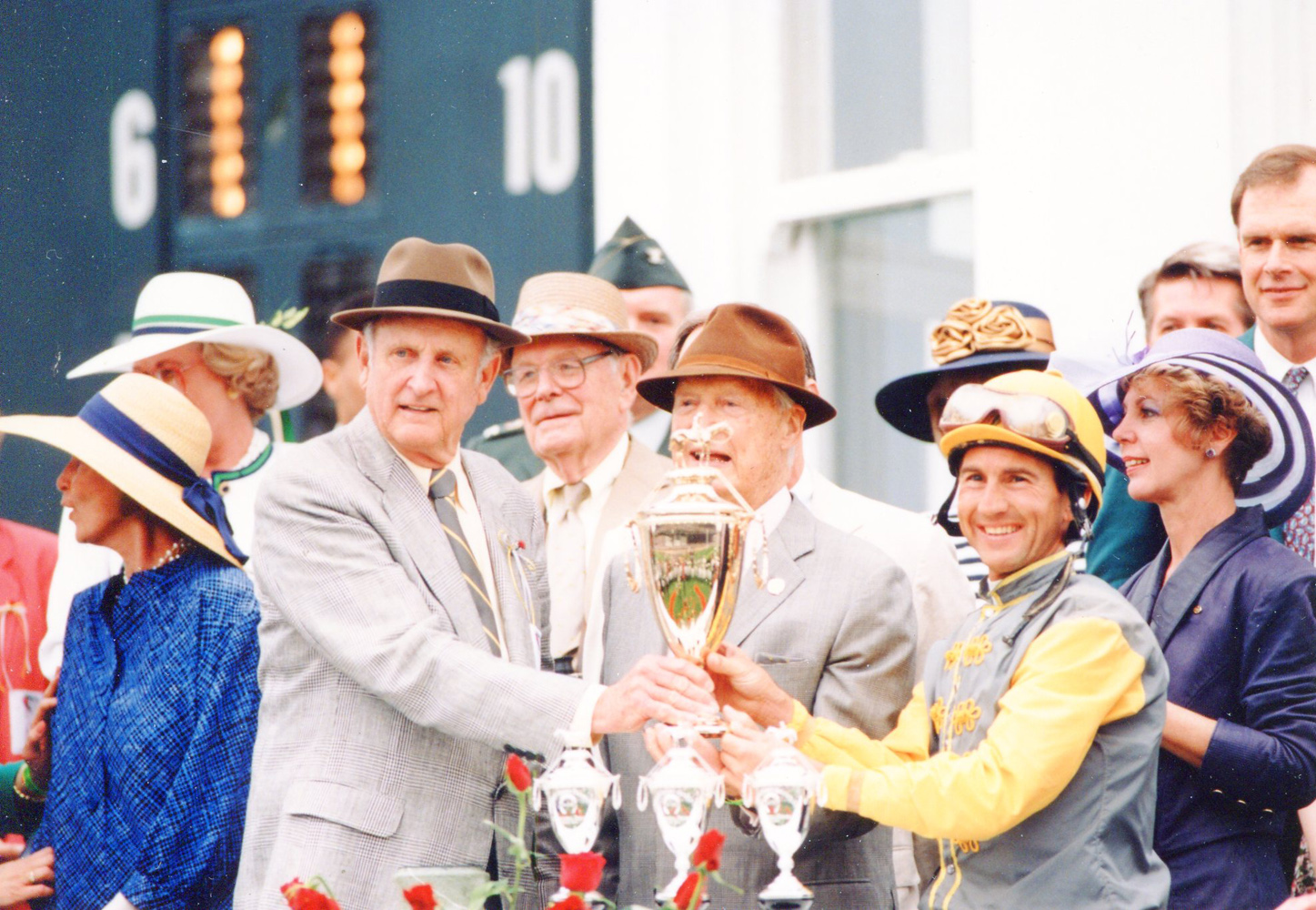 Mack Miller, Paul Mellon, and Jerry Bailey at the 1993 Kentucky Derby trophy presentation (Museum Collection)