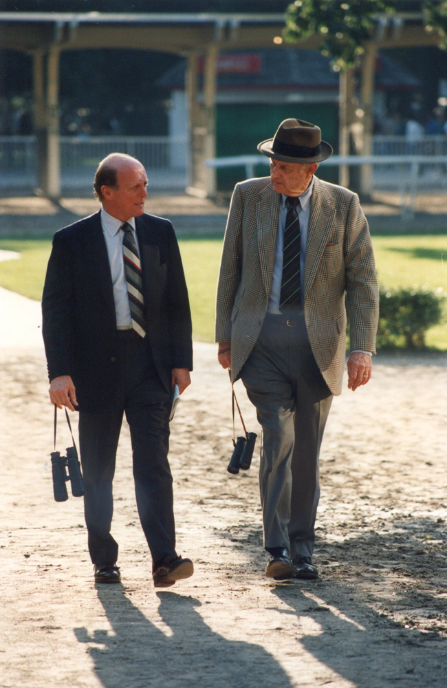 Hall of Fame trainers LeRoy Jolley and Mack Miller walking in the Belmont Park paddock in 1992 (Barbara D. Livingston/Museum Collection)