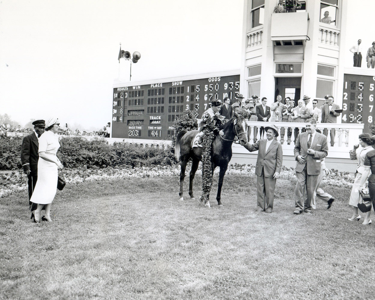 The winning connections of Determine, including trainer William Molter, celebrate in the winner's circle after winning the 1954 Kentucky Derby (Churchill Downs Inc./Kinetic Corp. /Museum Collection)