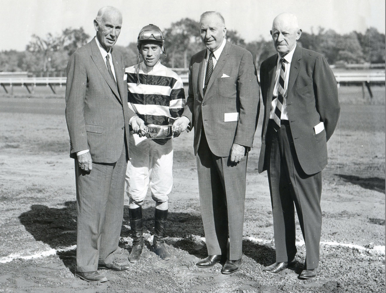 Owner George D. Widener, Jr., jockey John Rotz, John Hanes, and trainer Bert Mulholland at the trophy presentation for the 1966 Flash Stakes at Saratoga, won  by Bold Hour (Museum Collection)