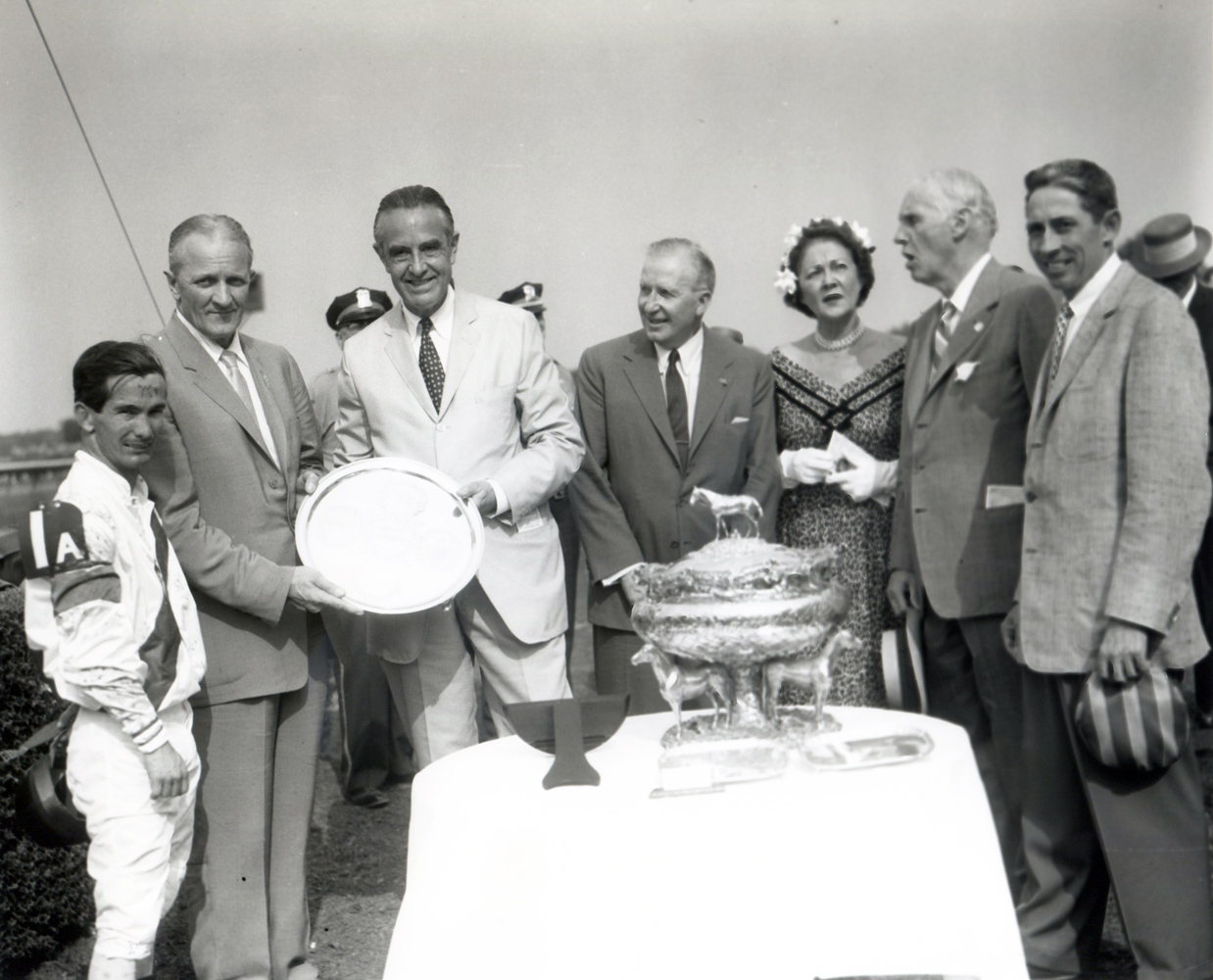 New York Governor Averill Harriman presents jockey Bill Shoemaker at far left, owner Ralph Lowe next to him, and trainer John Nerud at far right with the 1957 Belmont Stakes trophy (Keeneland Library Morgan Collection/Museum Collection)
