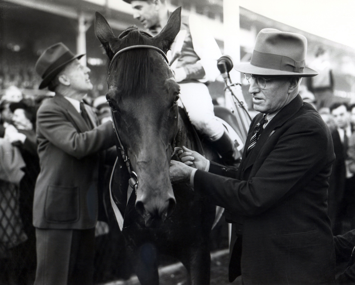 Tom Smith holds Seabiscuit's bridle at the 1938 Pimlico Special (George Woolf up) (Keeneland Library Cook Collection/Museum Collection)