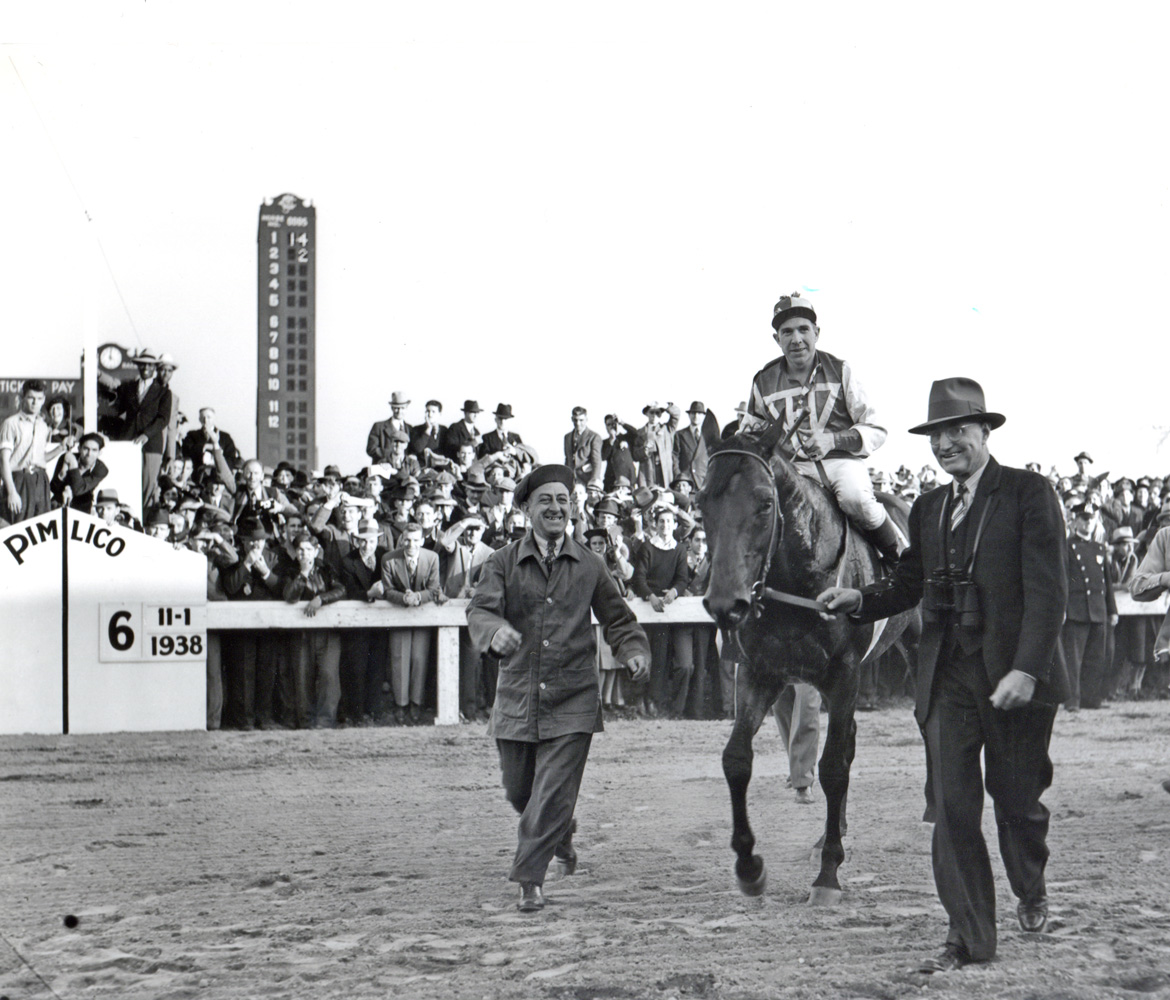 Tom Smith leads in Seabiscuit and George Woolf after they defeated Triple Crown winner War Admiral in the 1938 Pimlico Special match race (Keeneland Library Morgan Collection/Museum Collection)