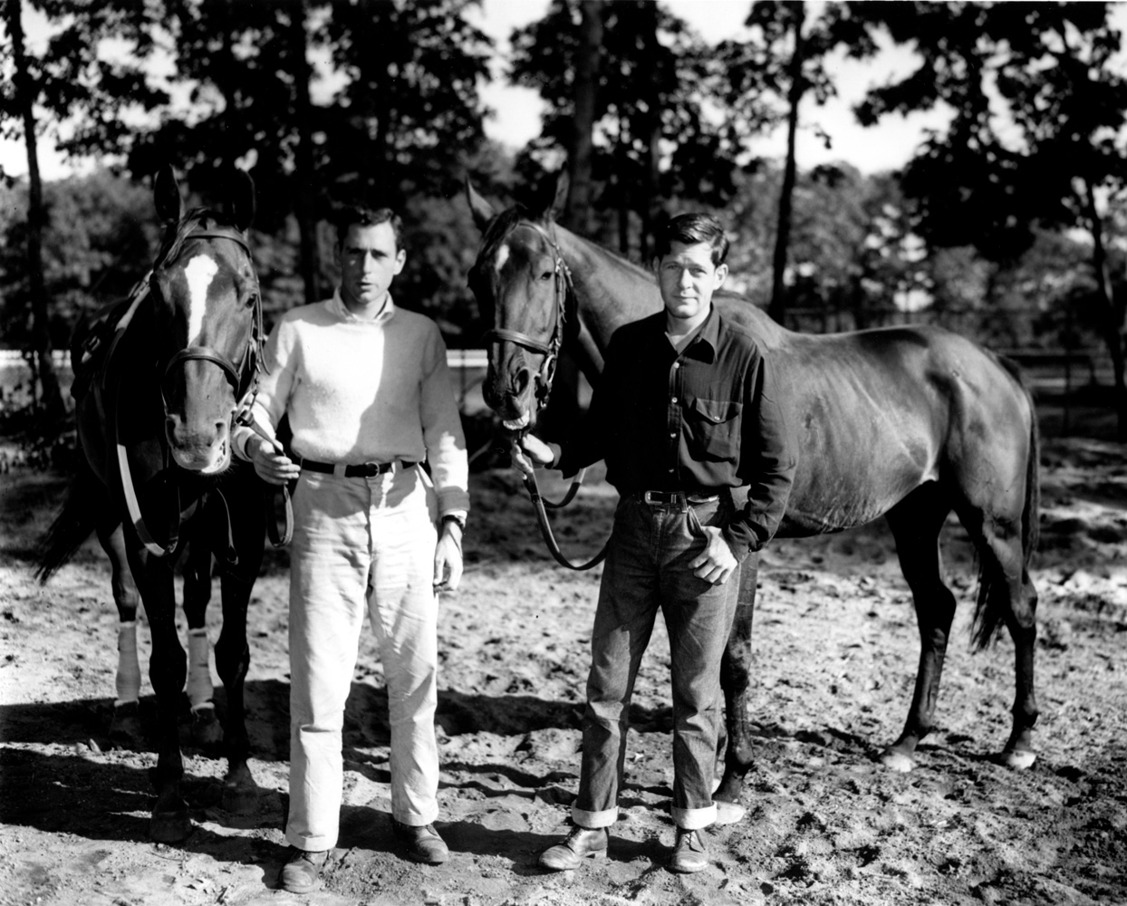 "D.M. ""Mikey"" Smithwick holding Neji with brother A.P. ""Paddy"" Smithwick holding Ancestor at Belmont, September 1957 (Keeneland Library Morgan Collection/Museum Collection)"
