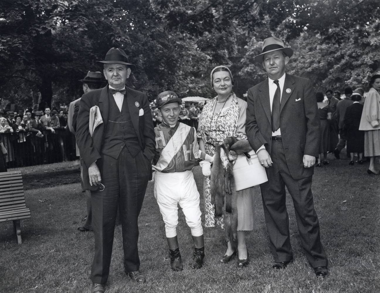 Mr. A. E. Reuben, jockey John Adams, Mrs. A. E. Reuben, and Harry Trotesk in the paddock at Belmont, May 1954 (Keeneland Library Morgan Collection/Museum Collection)