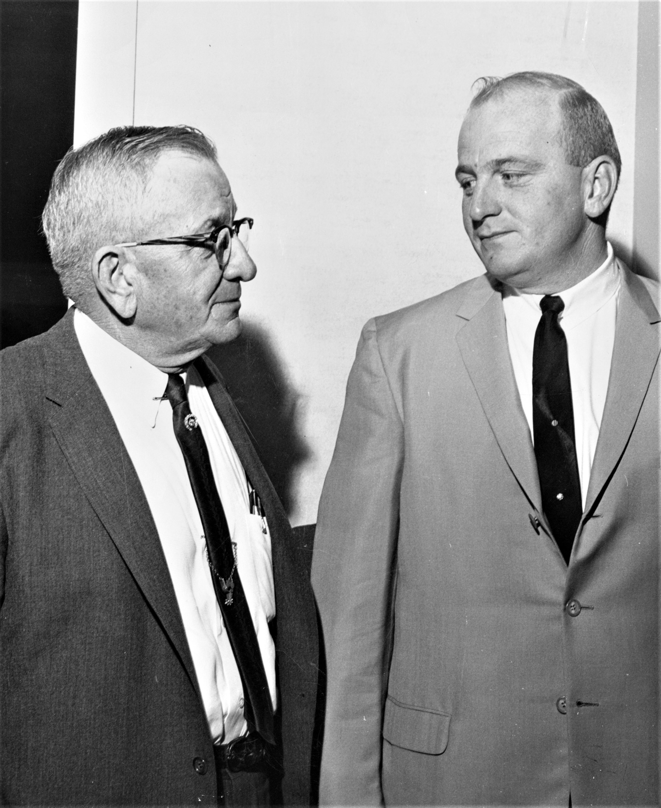 Marion Van Berg (left) and his son, Jack Van Berg, in 1965 (Keeneland Library Thoroughbred Times Collection)